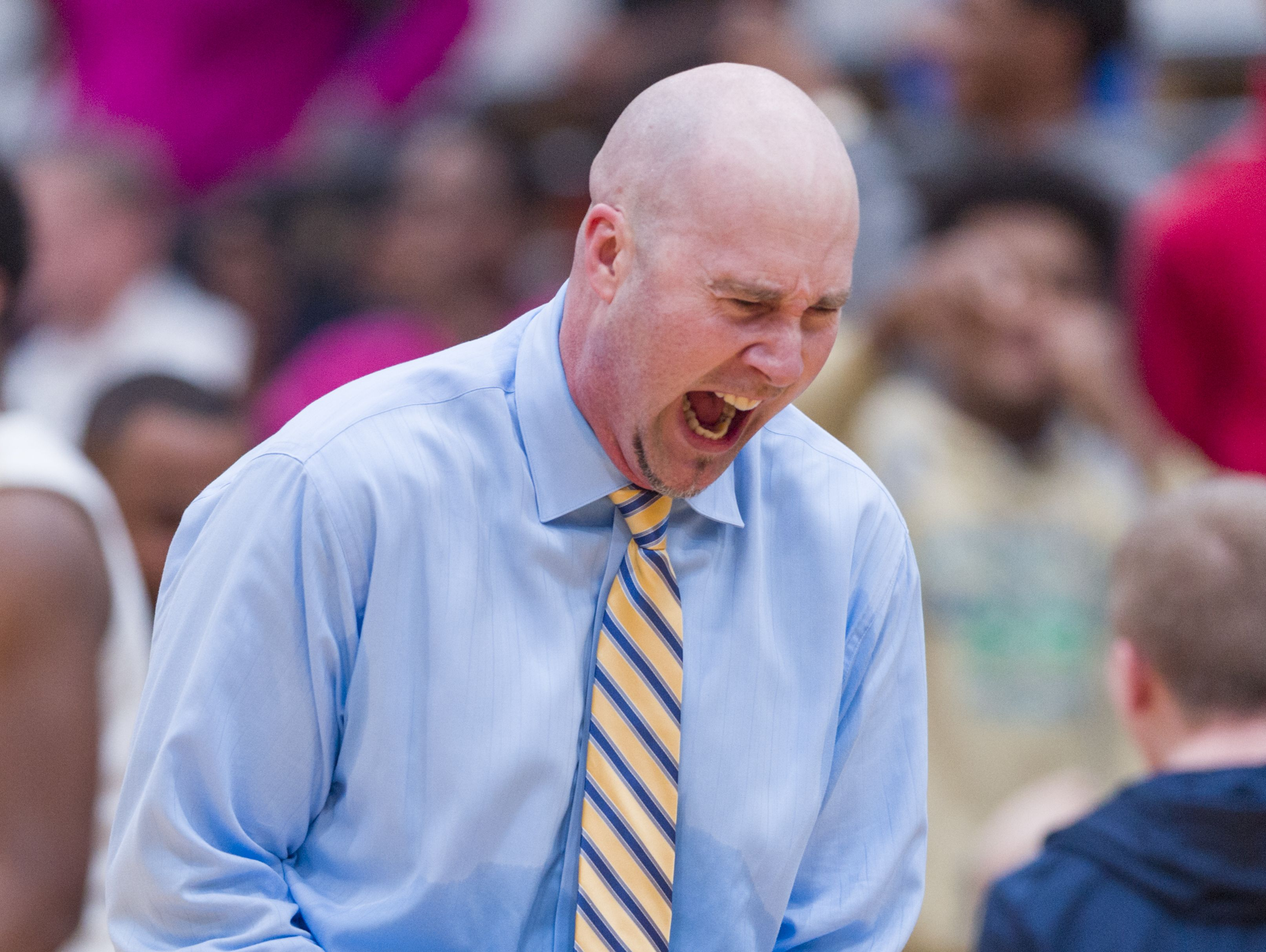 Cathedral coach Jason Delaney reacts after the team defeats Howe at the end of Saturday's City tournament semifinal.