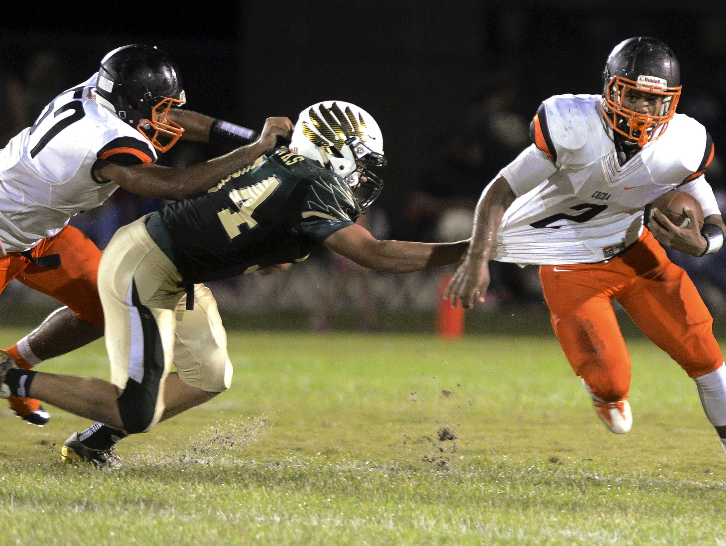 Cocoa's Timmy Pratt tries to get past Brandon Mays of Viera during a 2016 game in Viera.