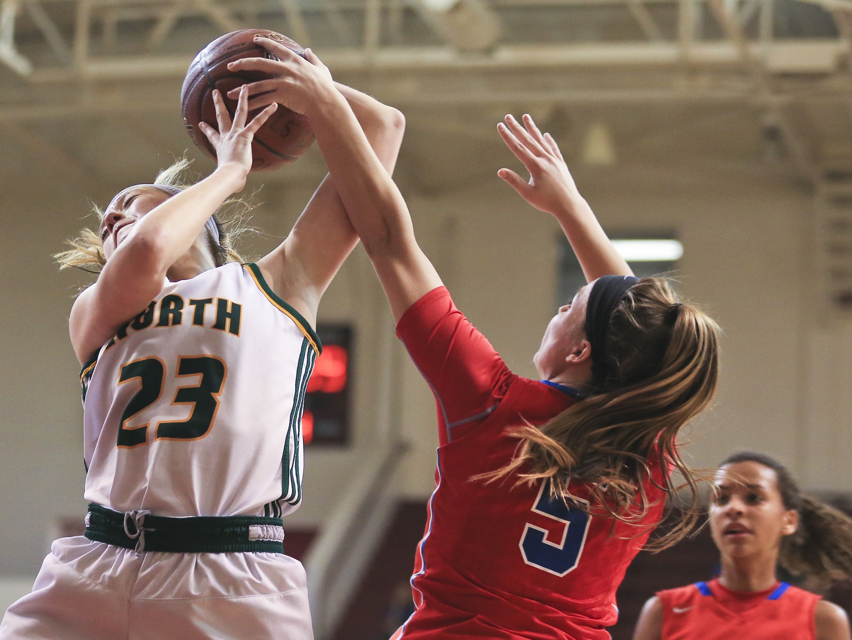 North Bullitt's Lauren Deel is pressured by Christian Academy's Emma Wesley in the first game of the Girls' LIT at Bellarmine University. Deel finished with 10 points and 11 rebounds. The Lady Centurions beat the Lady Eagles 57-45.