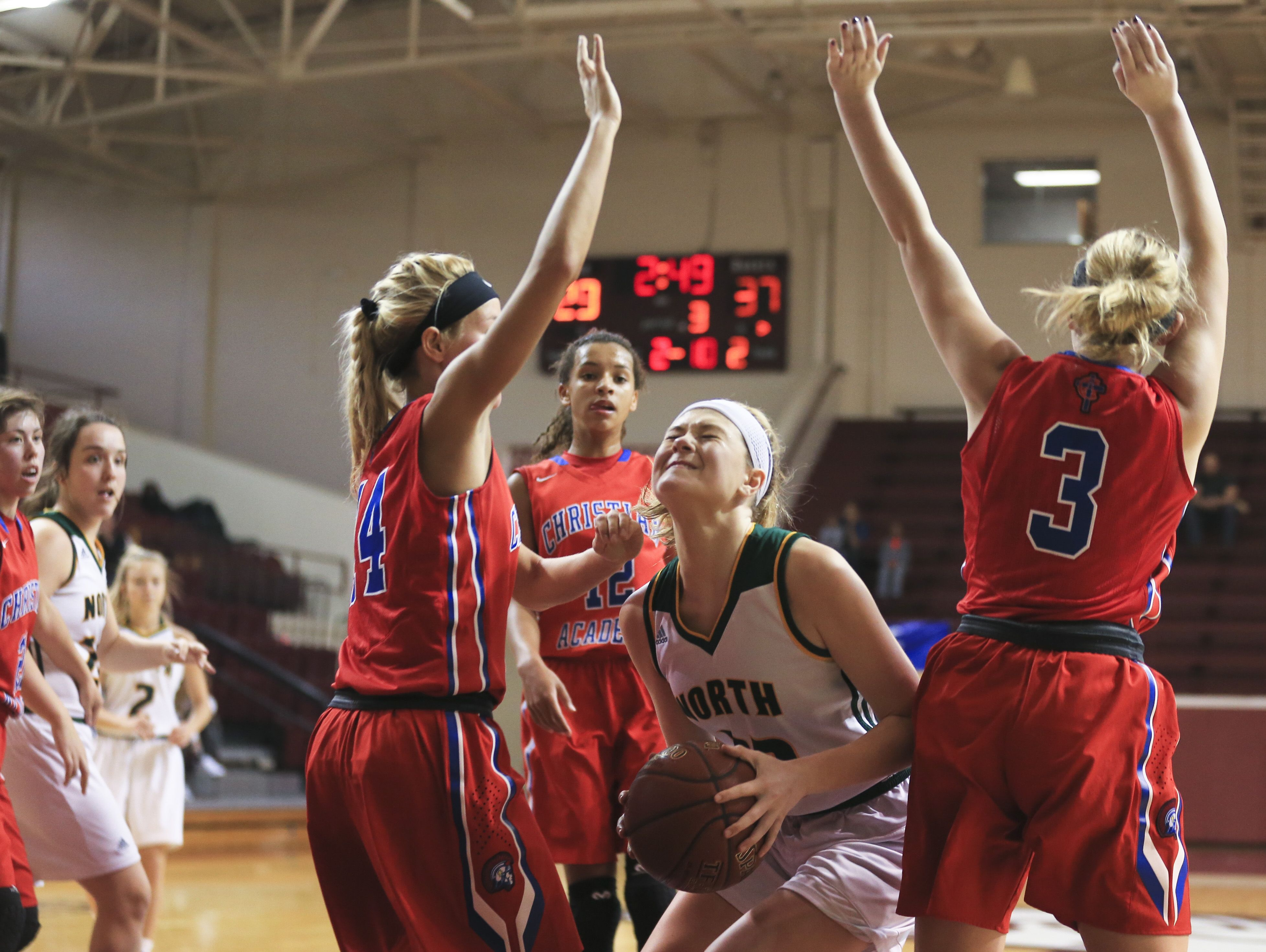 North Bullitt's Lauren Deel was pressured by Christian Academy defenders in the first game of the Girls' LIT at Bellarmine University. Deel finished with 10 points and 11 rebounds. The Lady Centurions beat the Lady Eagles 57-45.