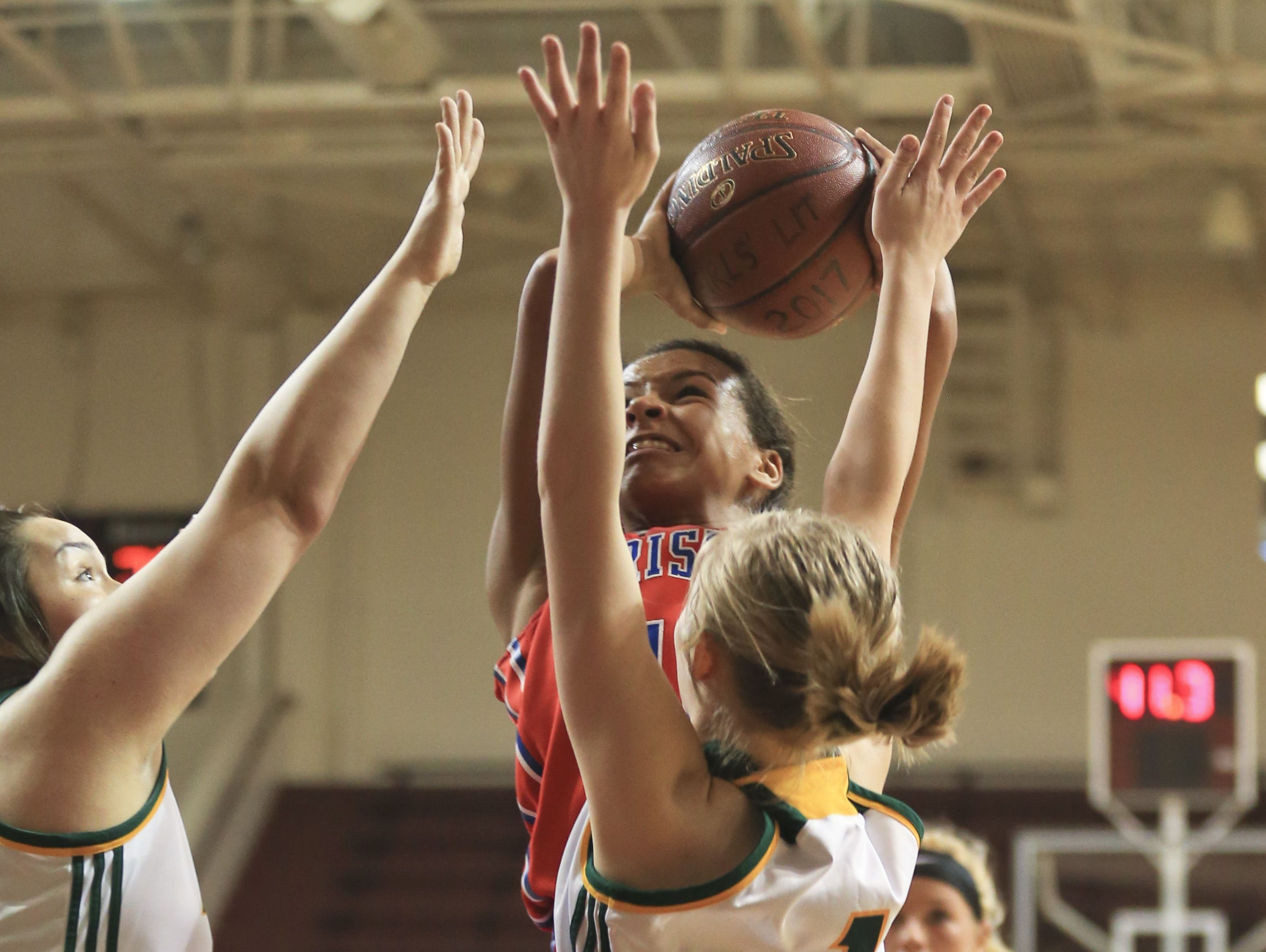 Christian Academie's Shelby Calhoun shoots over two North Bullitt defenders during the first game of the Girls' LIT at Bellarmine University Tuesday afternoon. Calhoun finished with 16 points and nine rebounds.