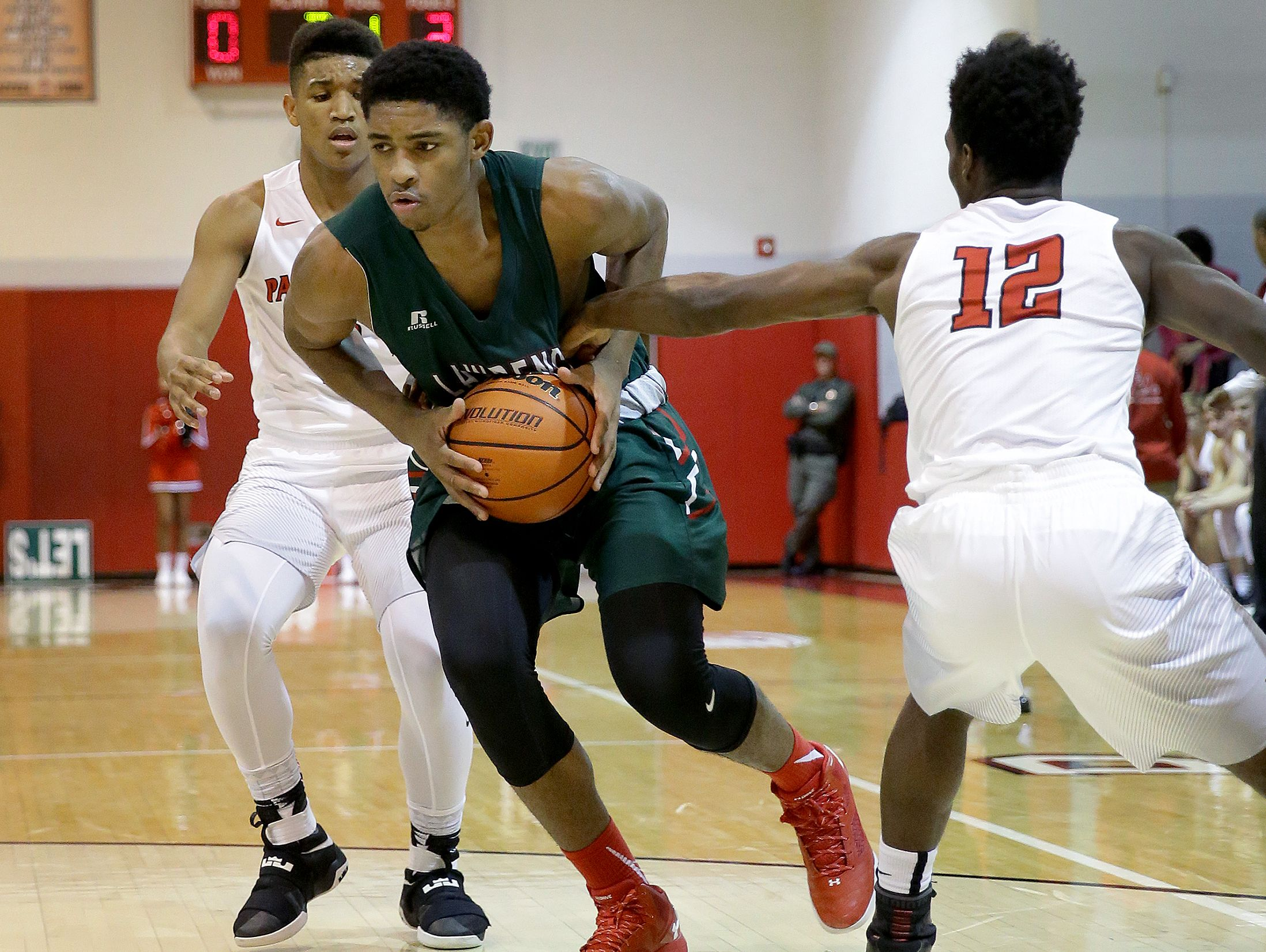 FILE -- Lawrence North Wildcats Kevin Easley (34) is fouled by Park Tudor Panthers Brent Brimmage (12) in the second half of their game Tuesday, November 29, 2016, evening at Park Tudor High School. The Lawrence North Wildcats defeated the Park Tudor Panthers 47-35.