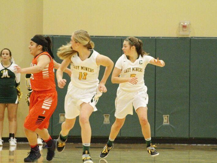Sisters Kenna Holt (No. 11) and Malia Holt (No. 5) play on the Bishop Manogue girls basketball team.