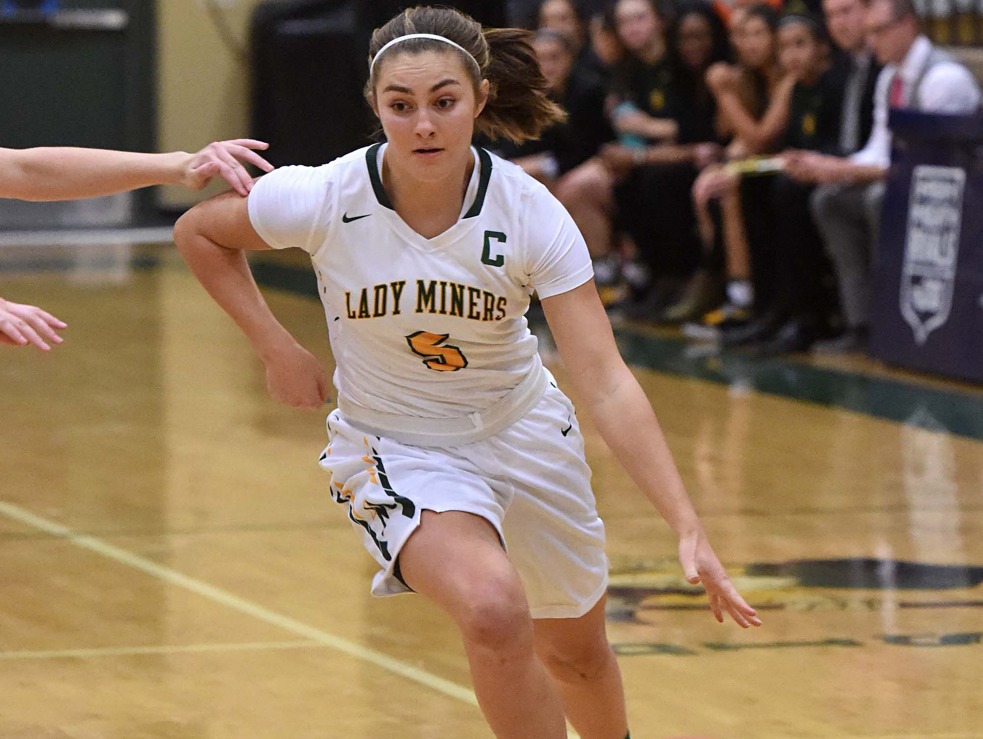 Bishop Manogue's Malia Holt dribbles against Reed on Dec. 6.