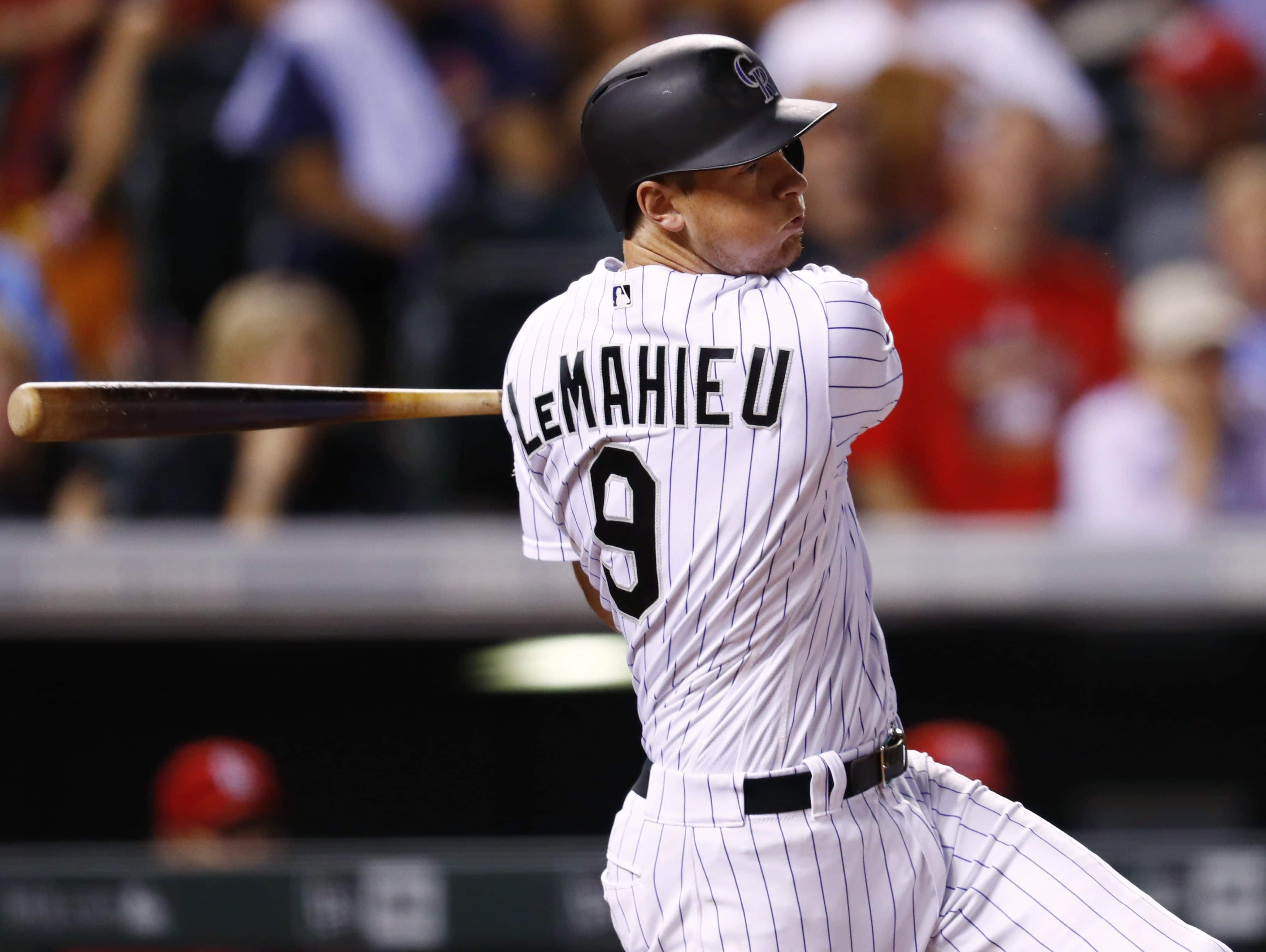 Colorado Rockies' DJ LeMahieu follows the flight of his double off St. Louis Cardinals pitcher Michael Wacha in the seventh inning Sept. 20, 2016 in Denver.