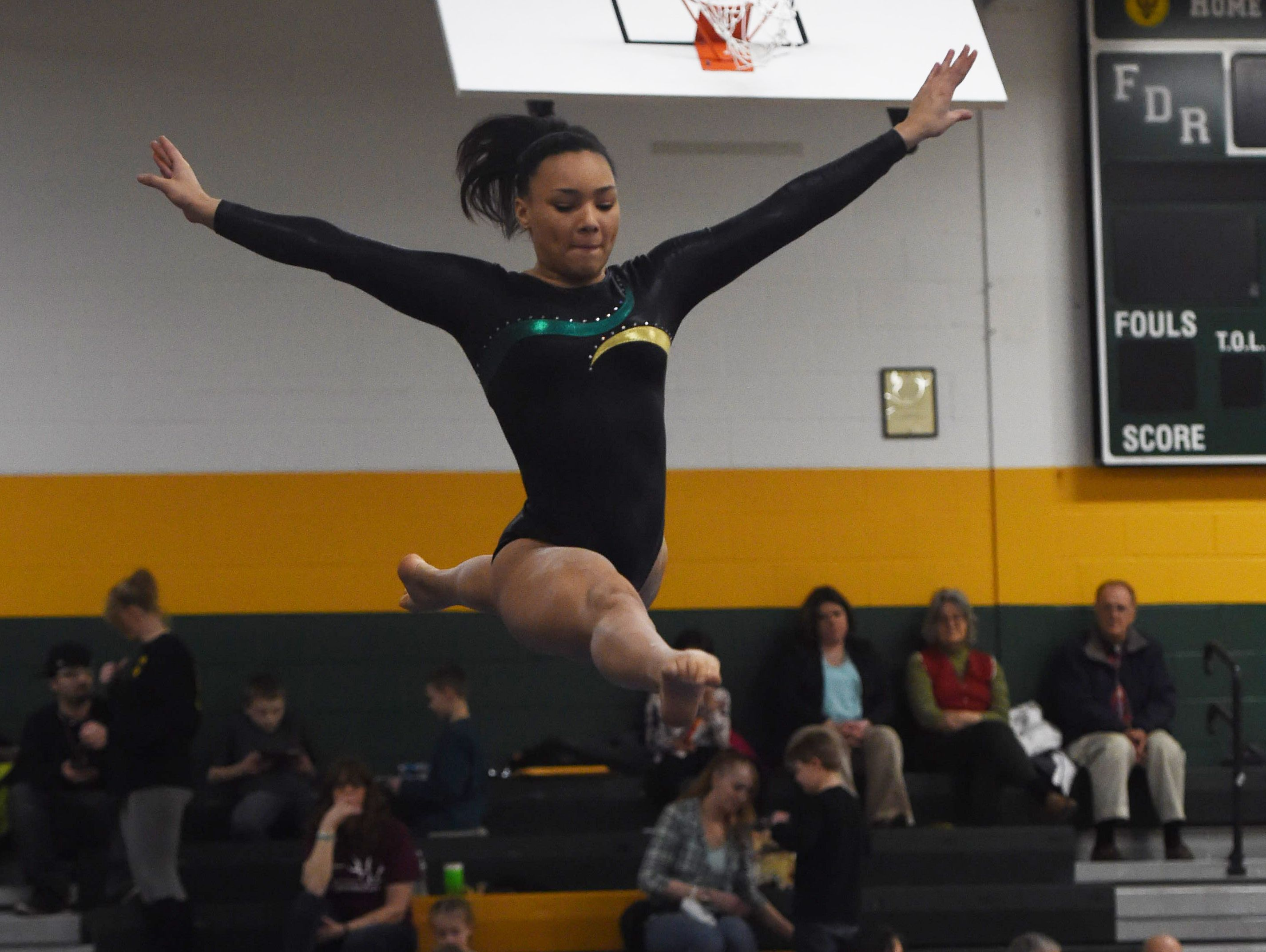 FDR's Dannika Bolitho performs her routine on the balance beam during the Katie Filiberti Memorial Gymnastics Invitational at FDR High School.