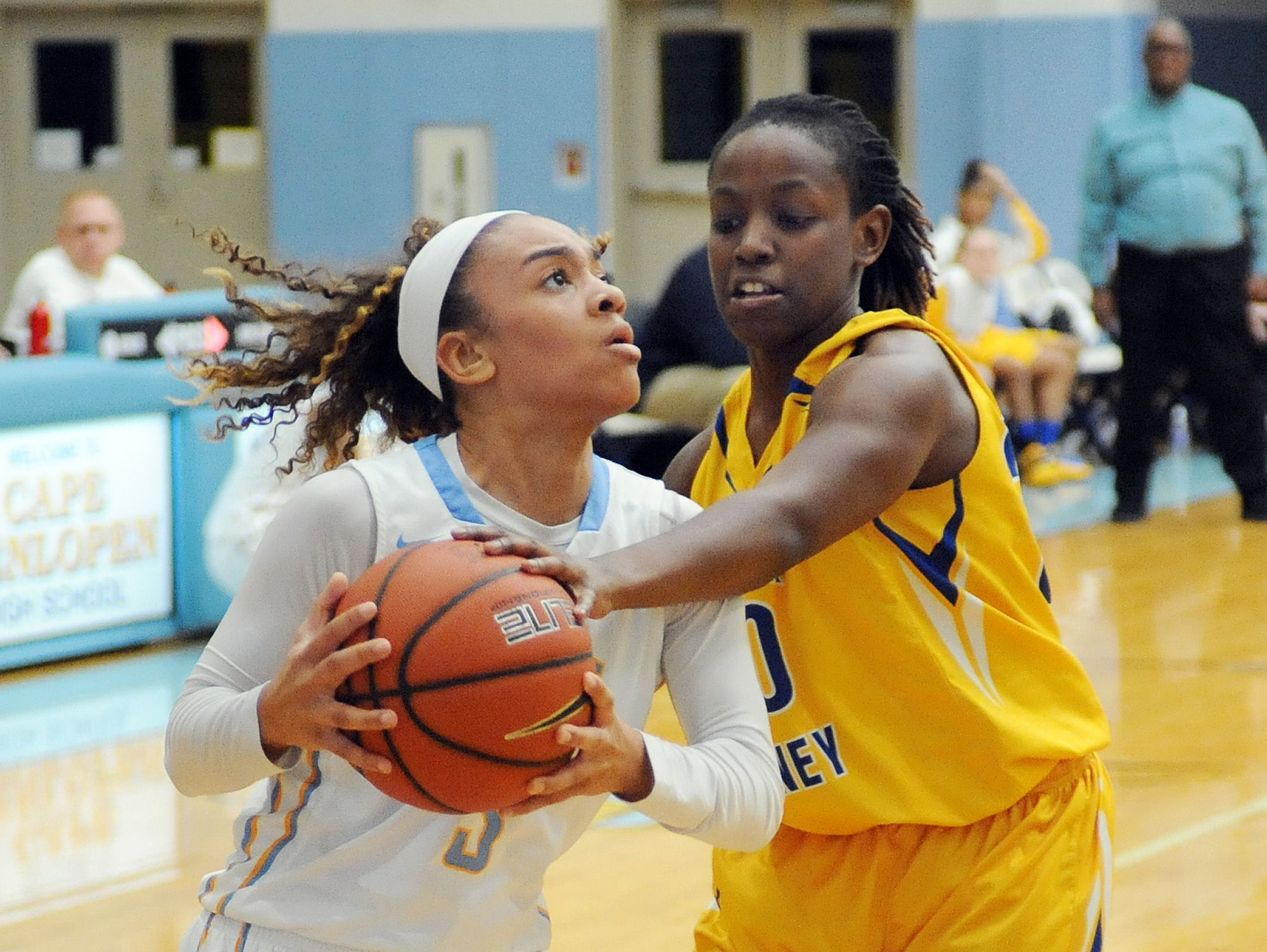 Cape Henlopen's #3 Dania Cannon drives for basket as she is fouled by Caesar Rodney's #30 Destiny Johnson.