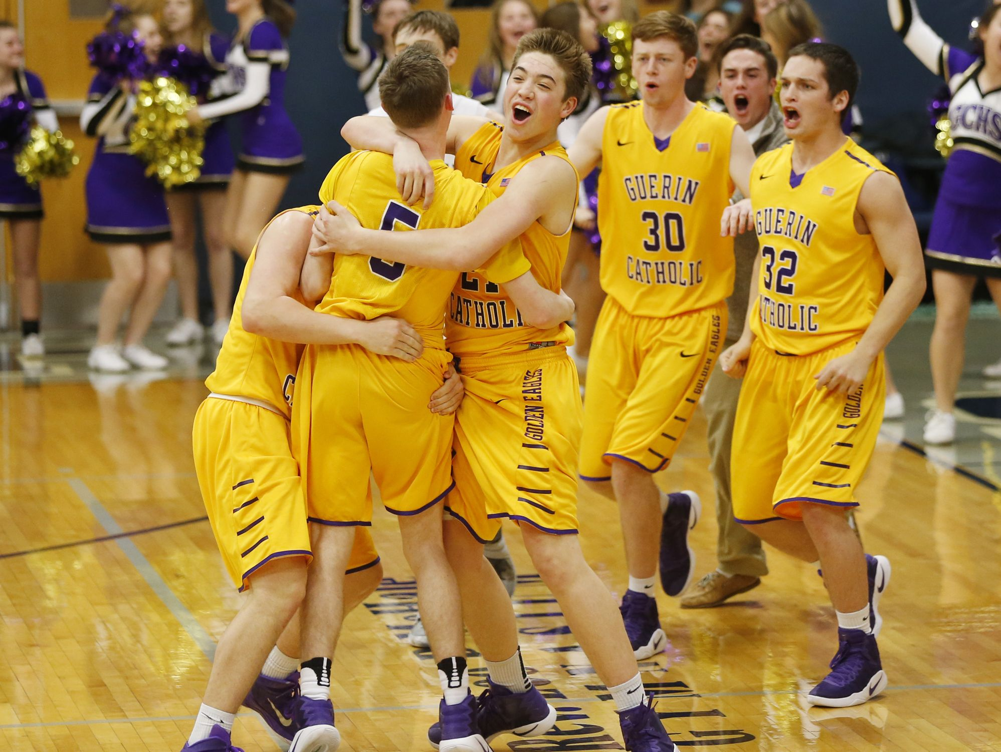 Guerin Catholic players mob Kian Sills (5) after his three-point basket at the sealed a 52-49 victory over Central Catholic Friday, January 27, 2017, in Lafayette.