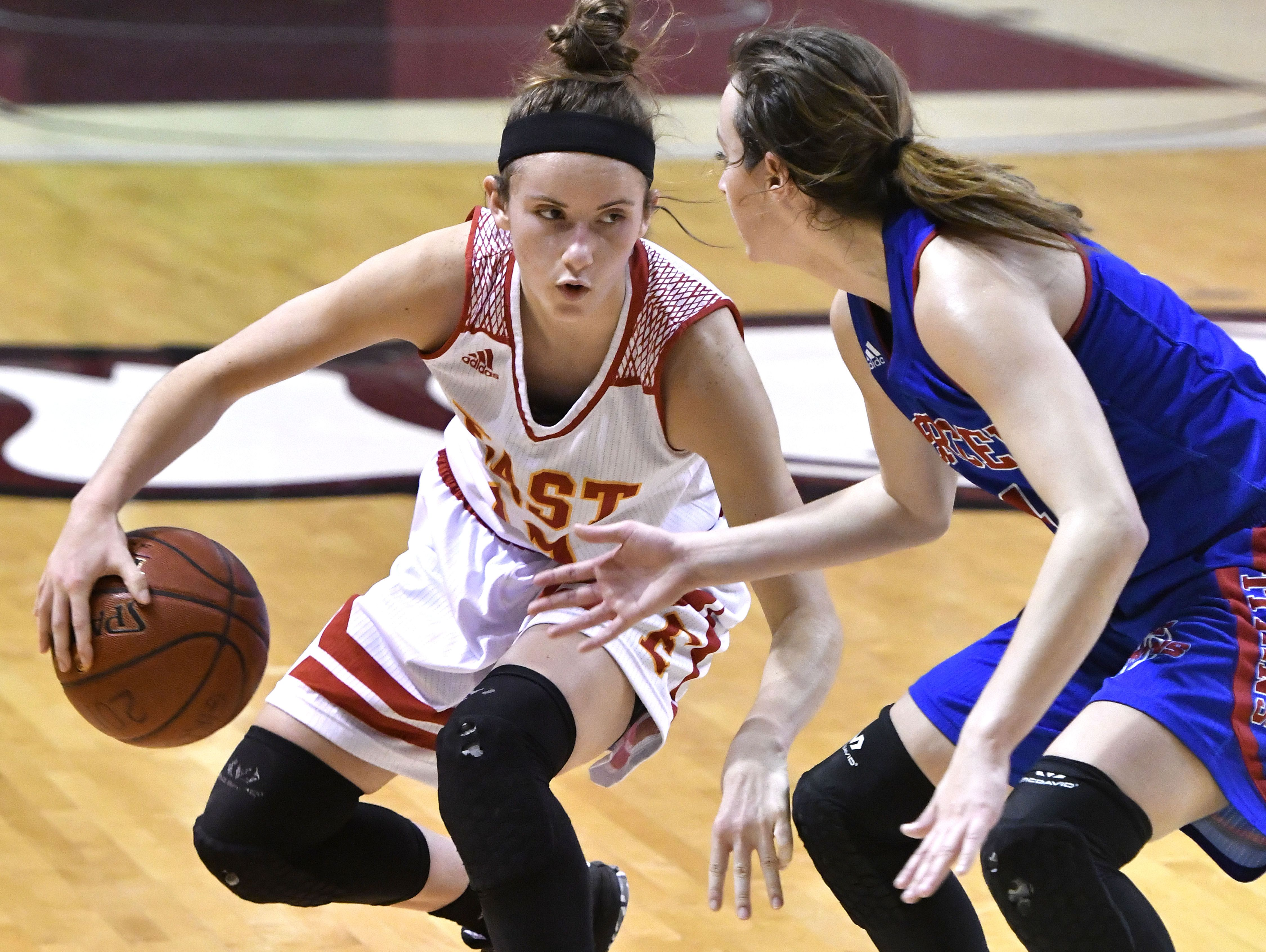 Bullitt East's Lindsey Duvall (12) attempts to drive past the defense of Mercer County's Seygan Robins (4) during their girls LIT game, Friday, Jan. 27, 2017 in Louisville Ky. (Timothy D. Easley/Special to the C-J)