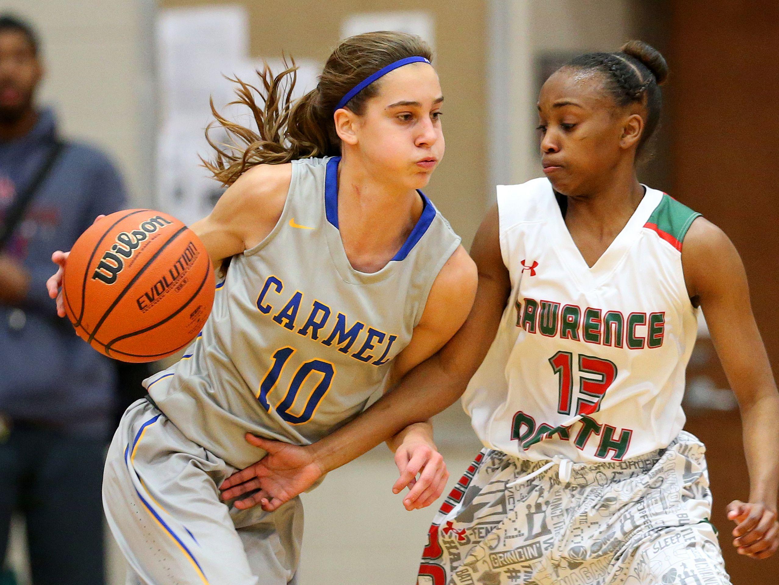 Lawrence NorthÕs Lauren Dickerson (13) defends against CarmelÕs Amy Dilk (10) on Dec. 1, 2015.