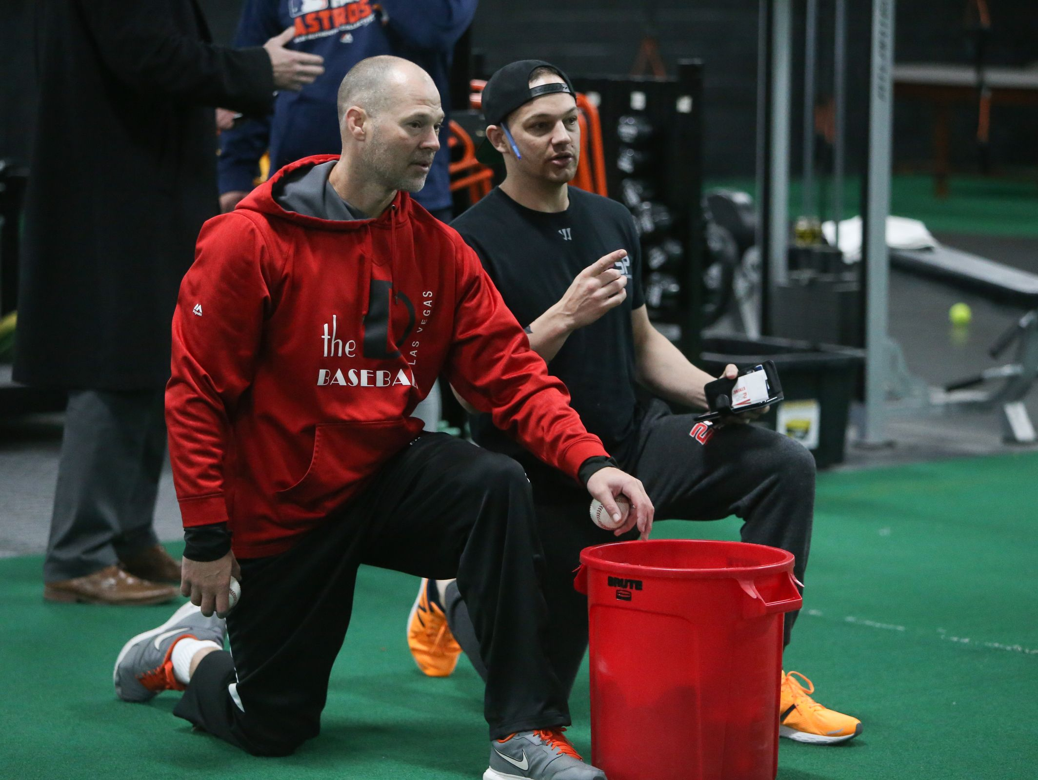 Infield coach Brian Kalczynski, left, and strength coach Joe Neal work with Colorado Rockies All-Star DJ LeMahieu at 2SP Sports Performance facility in Madison Heights on Jan. 16, 2017.