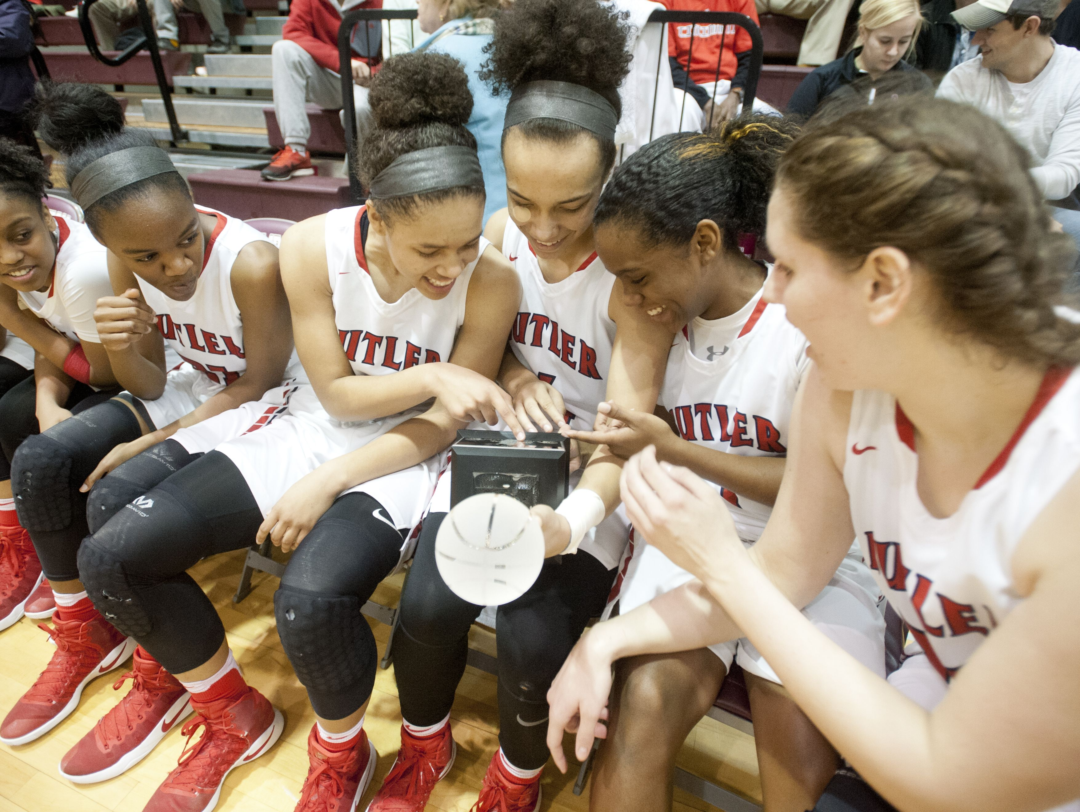 Butler celebrates their 2017 Girls' LIT championship trophy after defeating Male, 85-57. 28 January 2017