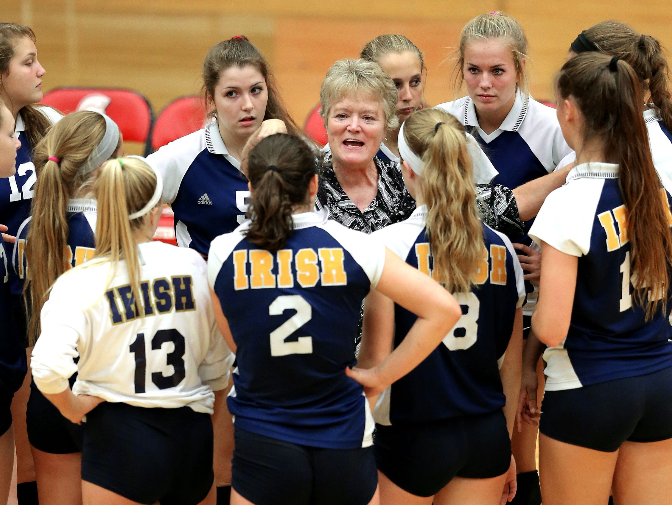 Jean Kesterson (center) coached four Indiana Gatorade Players of the Year and 17 All-Americans during her lengthy tenure at Cathedral.