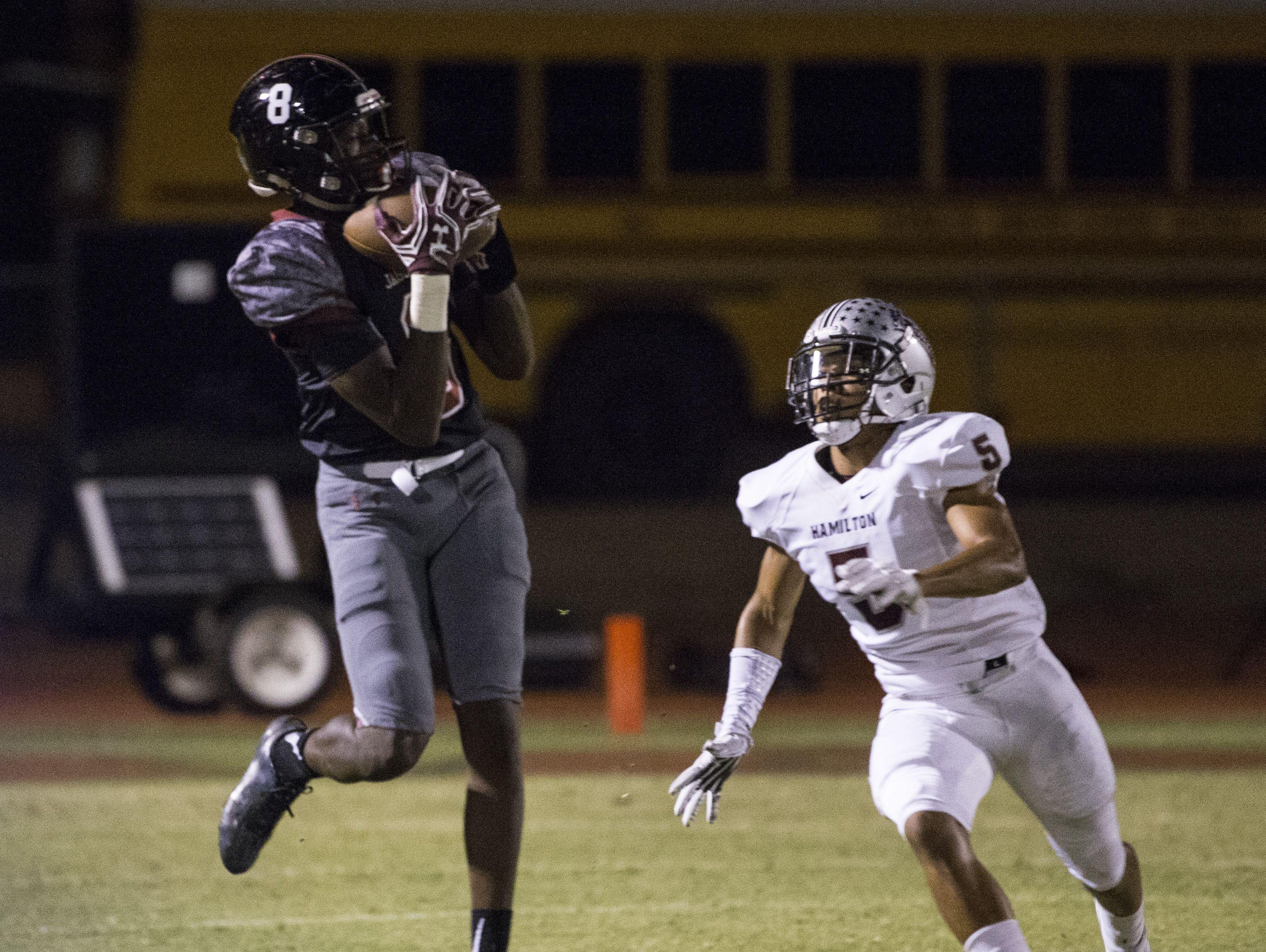 Desert Ridge's Jalen Harris (8) makes a catch over Hamilton's Ezekiel Robbins (5) in the first half at Desert Ridge High School on September 9, 2016 in Mesa, Ariz.
