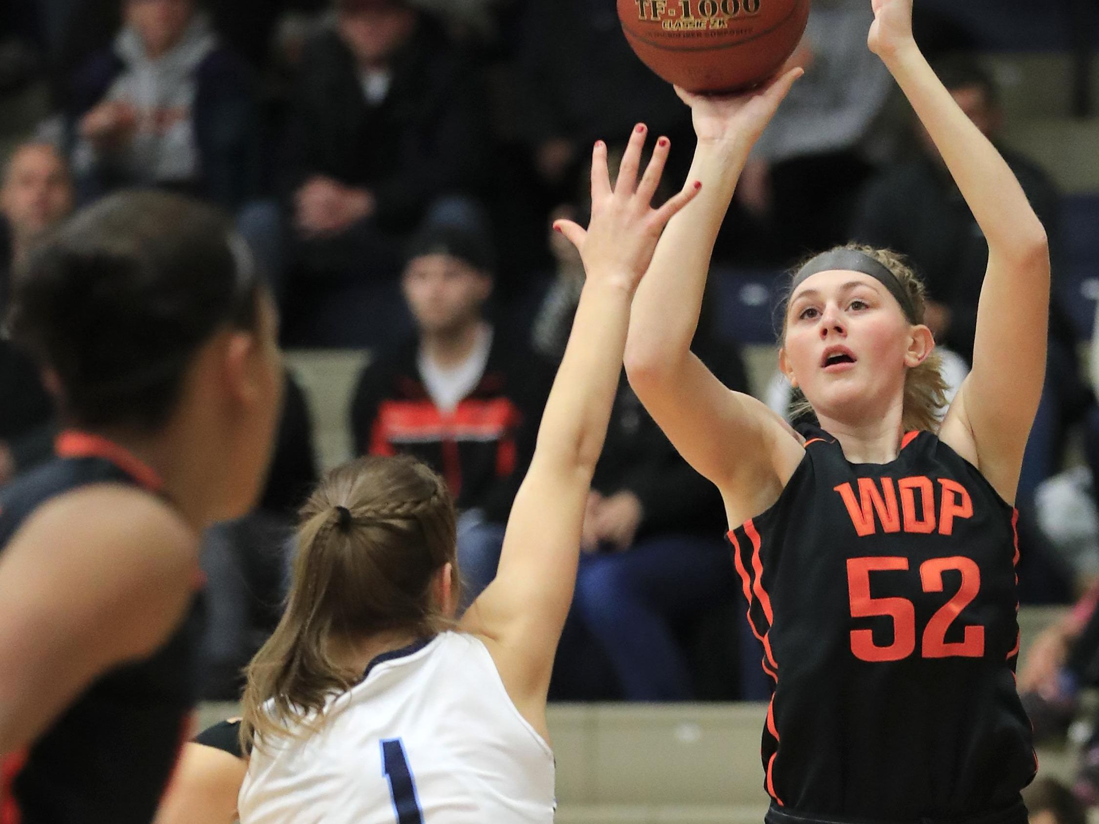 West De Pere's Hannah Stefaniak (52) shoots over Bay Port's Maddie Re (1) at on Dec. 30 at Bay Port High School. Stefaniak has helped the Phantoms climb the state rankings and maintain a 3.83 team GPA.