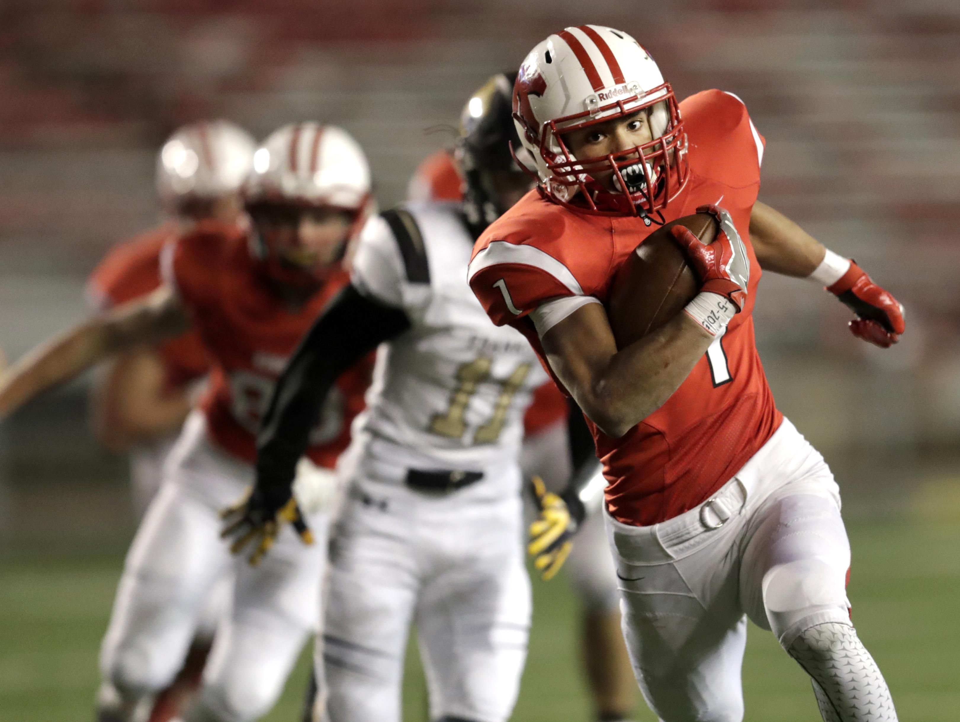 Running back D.J. Stewart and the Kimberly Papermakers won their fourth consecutive state football championship in November and have won 56 consecutive games.