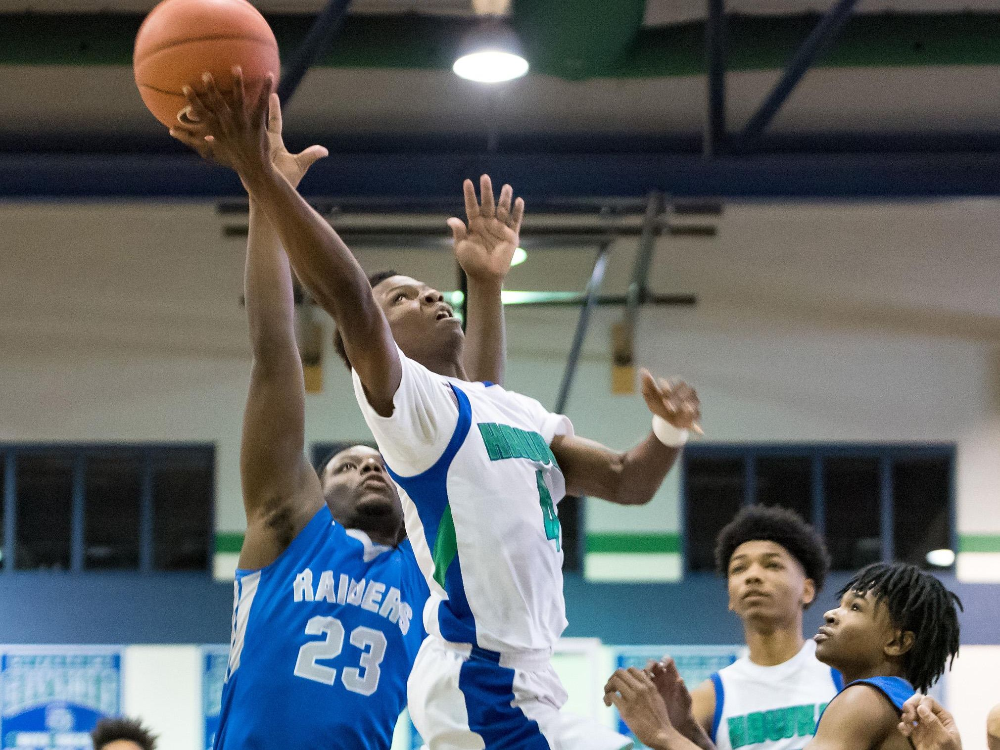 Prosper Tarley of St. Georges Technical takes the ball to the net as Shymere Vessels of Woodbridge tries to defend in boys basketball at St. Georges Technical High School in Middletown on Saturday afternoon.