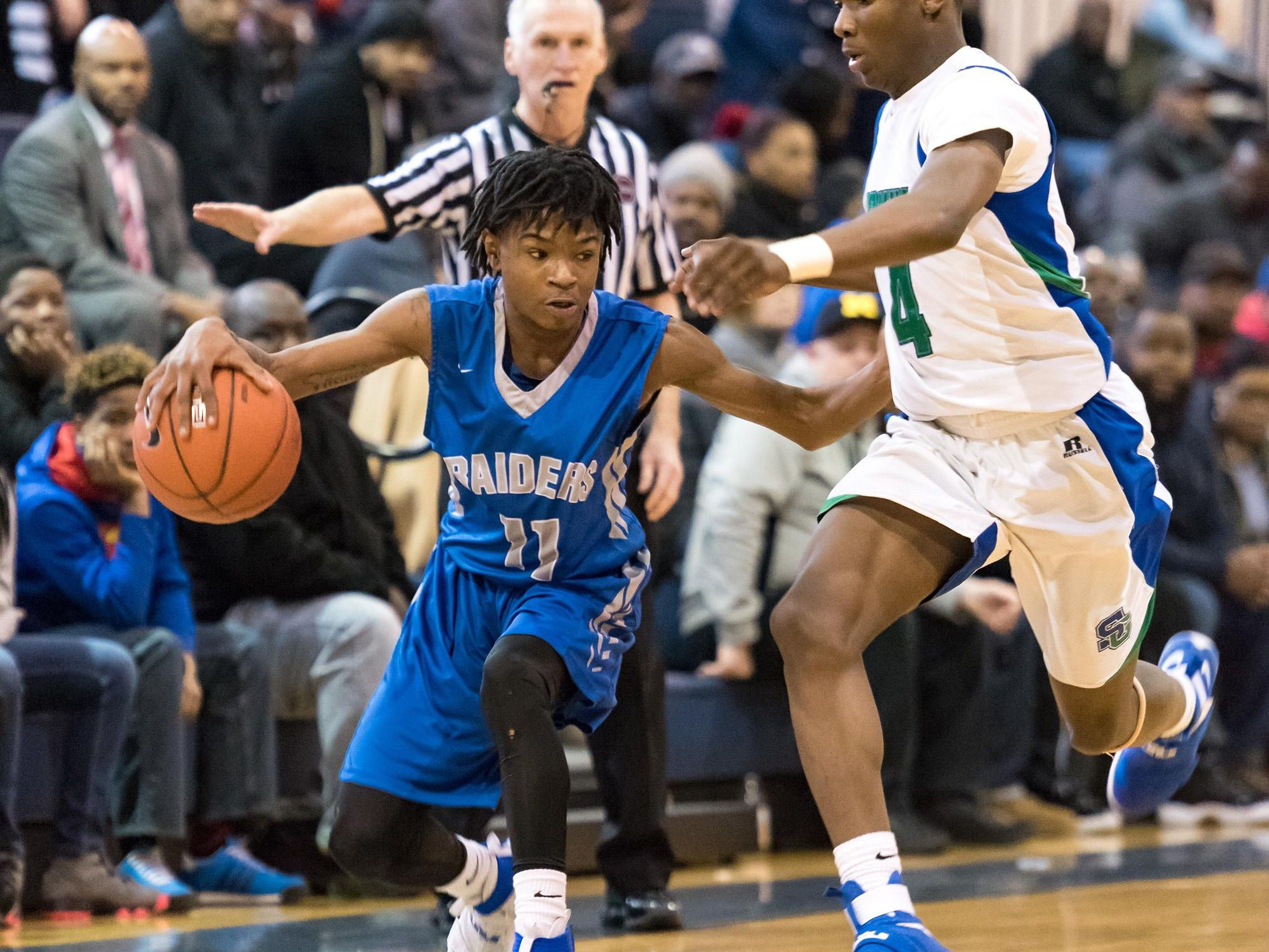 Brandon Palmer of Woodbridge takes the ball down the court past the defense of Prosper Tarley of St. Georges Technical in boys basketball at St. Georges Technical High School in Middletown on Saturday afternoon.