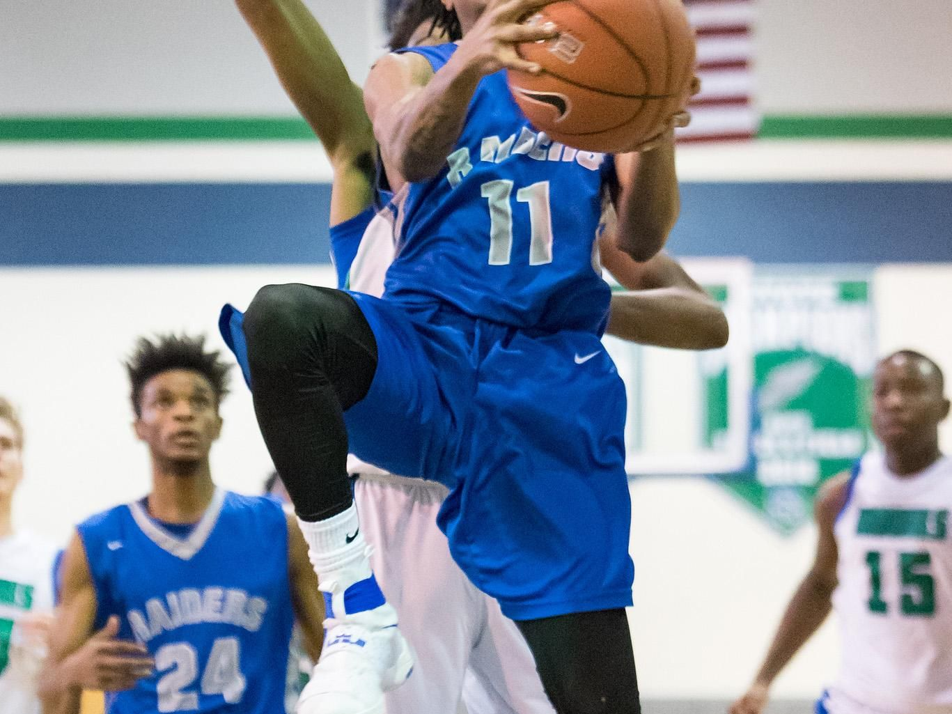 Brandon Palmer of Woodbridge takes the ball to the net in boys basketball at St. Georges Technical High School in Middletown on Saturday afternoon.