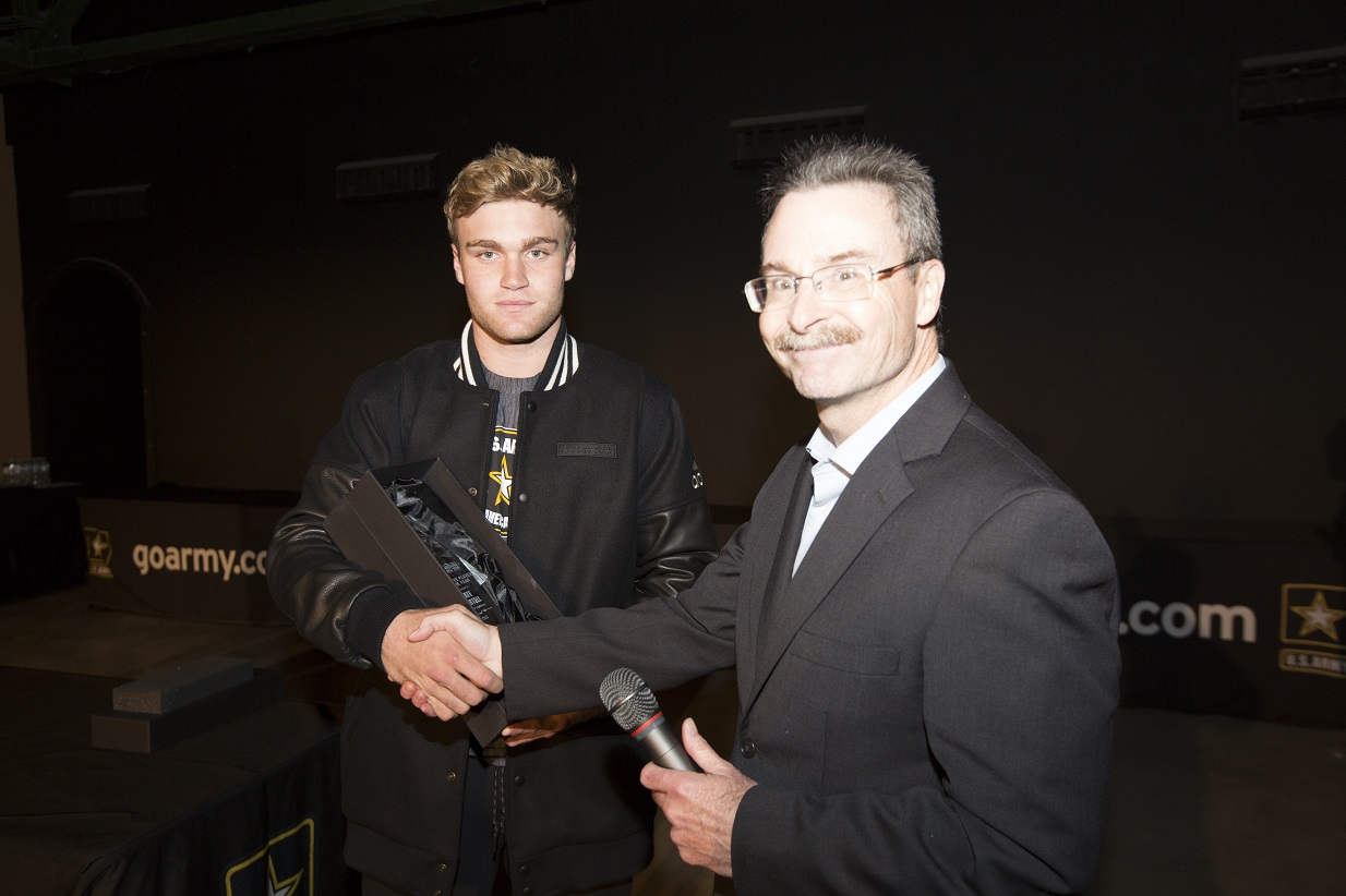 Jim Halley of USA TODAY Sports presents Tate Martell with the ALL-USA Offensive Player of the Year award (Photo: AAG)