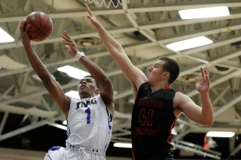 IMG Academy Trevon Duval (1) shoots against Wasatch Academy Matija Silic (41) in the second half at Blake Arena. IMG Academy defeated Wasatch Academy 61-51. (Photo: David Butler II/USA TODAY Sports).