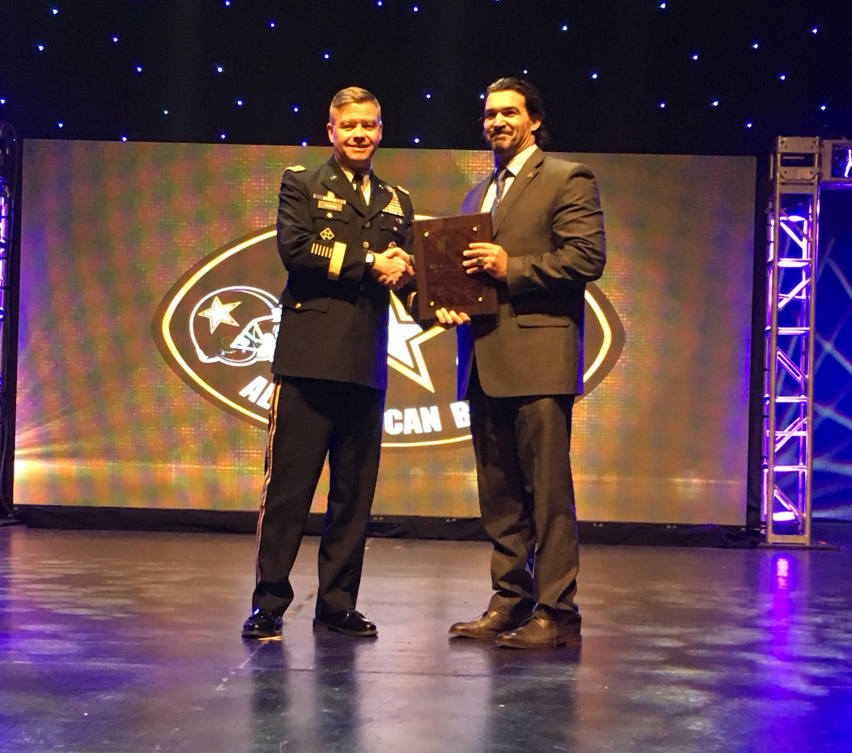 Gave Infante accepts his Army Bowl Coach of the Year trophy (Photo: AAG)