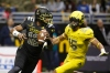 1/7/17 12:40:40 PM -- San Antonio, TX, U.S.A -- East quarterback Tua Tagovailoa (12) scrambles for yardage as he is pressured by West defensive lineman Jaelan Phillips (15) during U.S. Army All-American Bowl high school football game at the Alamodome. -- Photo by USA TODAY Sports Images, Gannett ORG XMIT: US 135880 Army All-America 1/7/2017 [Via MerlinFTP Drop]