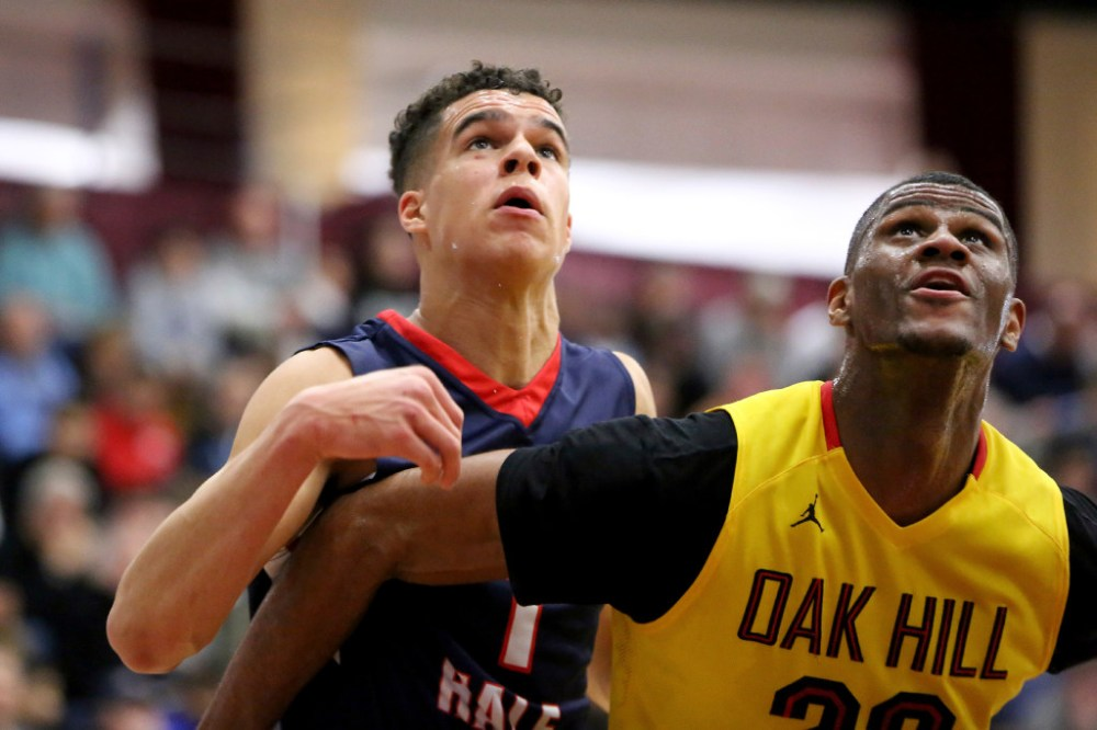 Michael Porter Jr. (1) and Billy Preston (23) battle during the Hoophall Classic. (Photo: (AP Photo/Gregory Payan) .