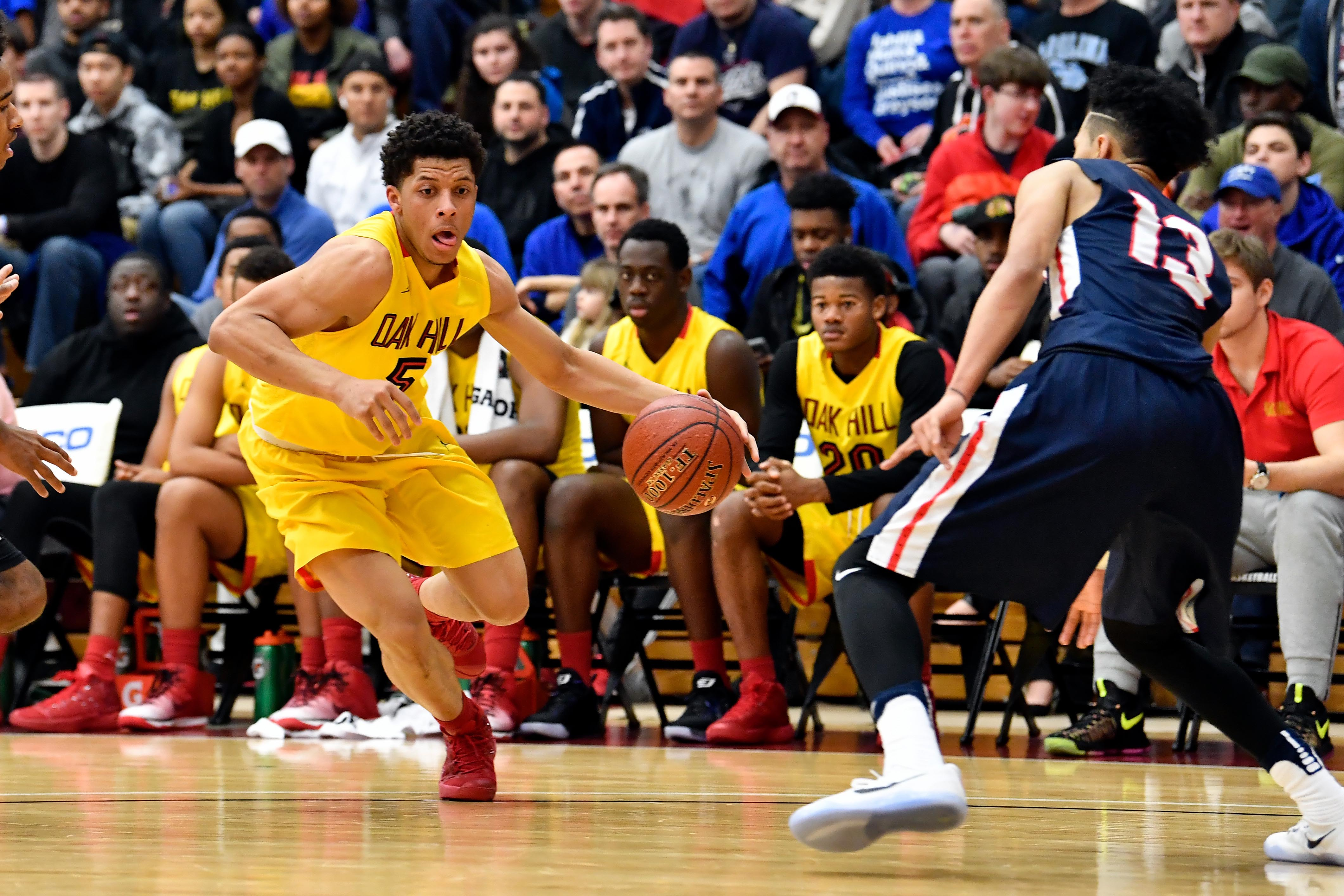 Jan 16, 2017; Springfield , MA, USA; Oak Hill Academy Warriors player Lindell Wigginton (5) drives to the basket around Nathan Hale High School Raiders player Tre-Var Holland (13) at Blake Arena. Mandatory Credit: Brian Fluharty-USA TODAY Sports ORG XMIT: USATSI-355414 ORIG FILE ID: 20170116_ads_fb7_152.JPG