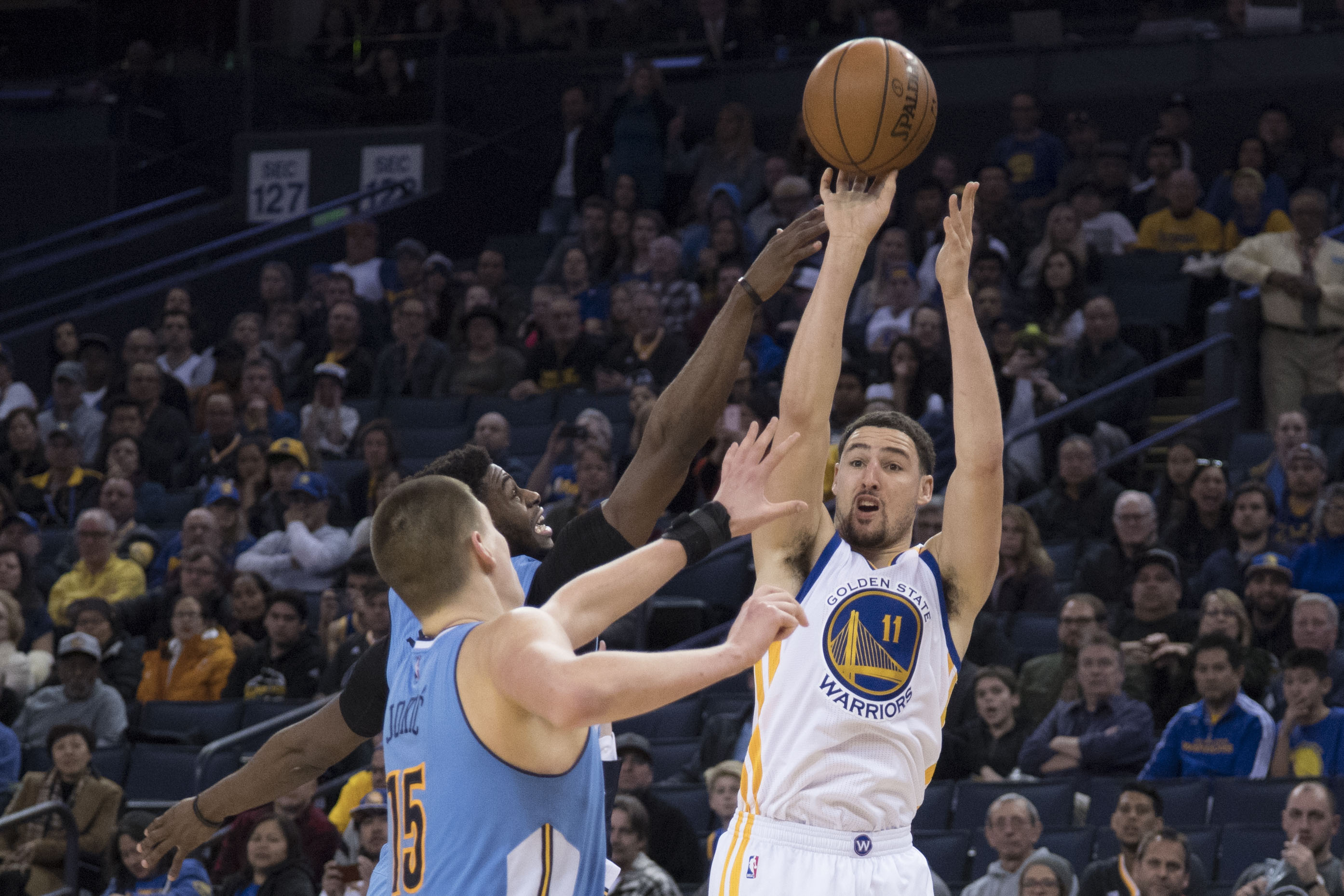 January 2, 2017; Oakland, CA, USA; Golden State Warriors guard Klay Thompson (11) shoots the basketball against Denver Nuggets forward Nikola Jokic (15) during the fourth quarter at Oracle Arena. The Warriors defeated the Nuggets 127-119. Mandatory Credit: Kyle Terada-USA TODAY Sports ORG XMIT: USATSI-324396 ORIG FILE ID:  20170102_kkt_st3_013.jpg