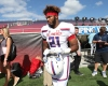 1/1/17 1:02:17 PM -- Orlando, FL, U.S.A  -- Team Highlight linebacker Nathan Proctor Jr. (21) goes back onto the field after announcing that he'll attend the Virginia Tech University during the 2017 Under Armour All-America High School Football game. Team Armour defeated Team Highlight 24-21. --    Photo by Matt Stamey-USA TODAY  Sports Images, Gannett ORG XMIT:  US 135884 Under Armour foo 1/1/2017 [Via MerlinFTP Drop]