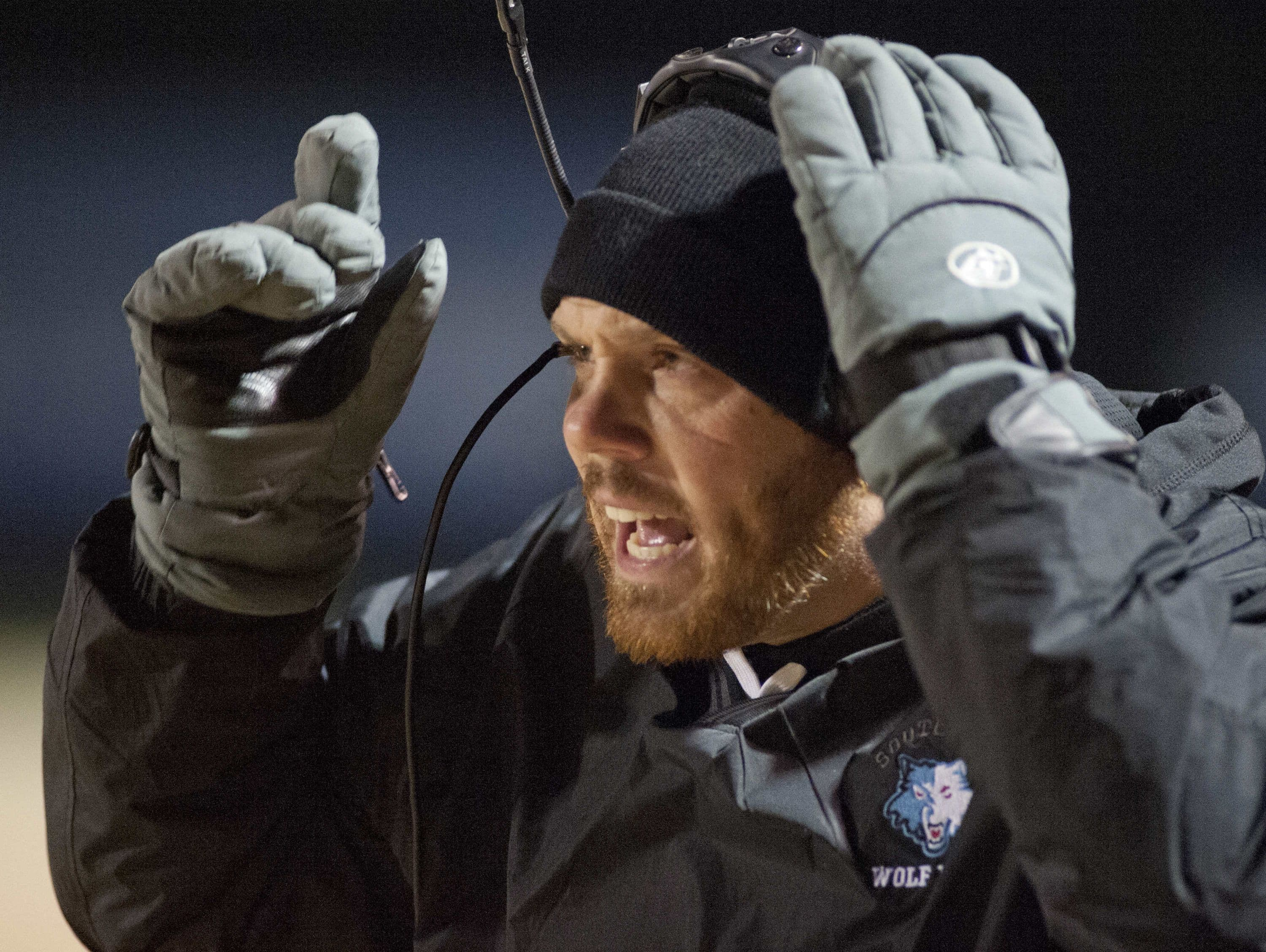 Iroquois Raiders' head football coach Preston King yells instructions to his team during the game. 21 November 2014