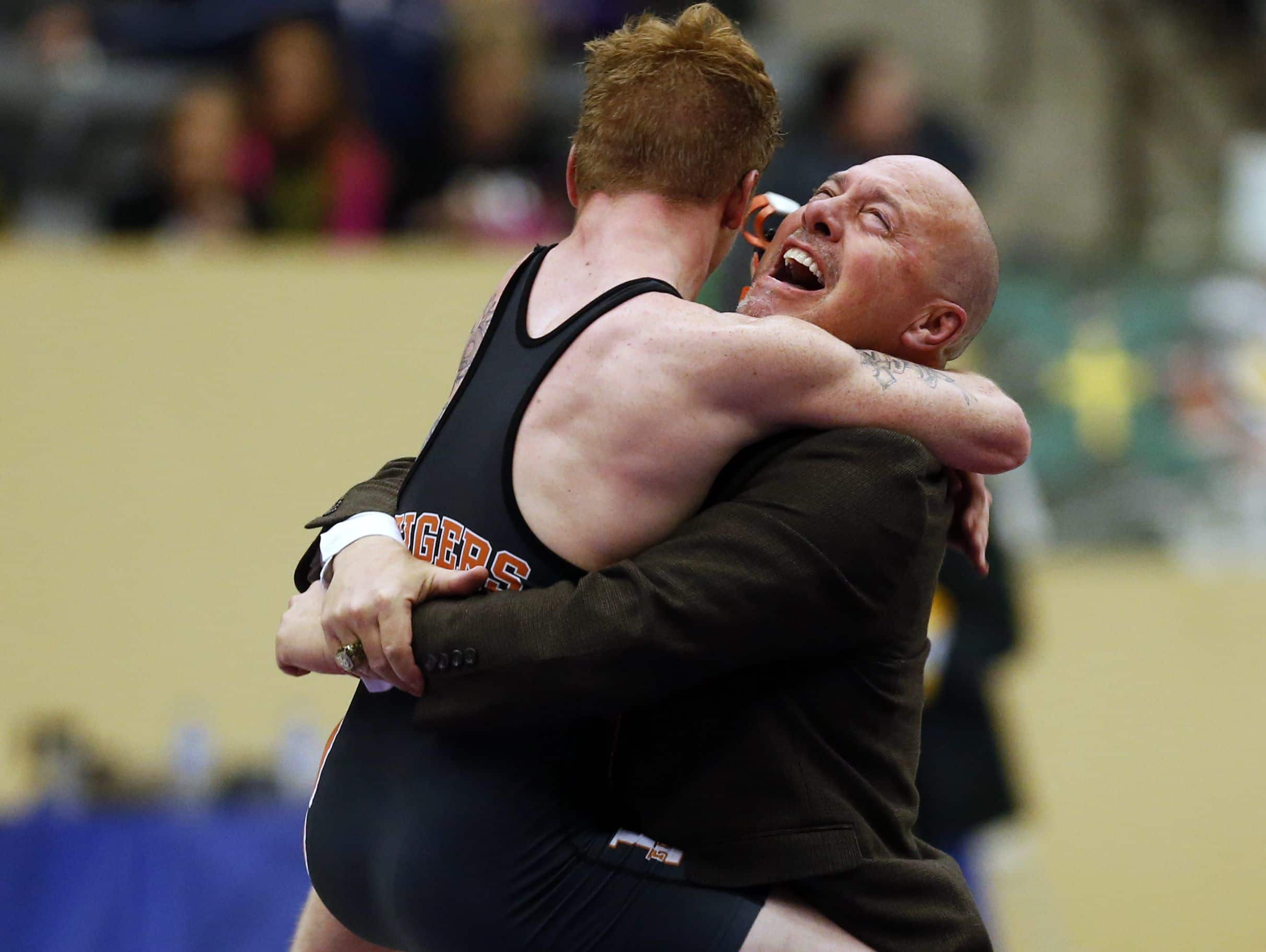 Fern Creek's AJ Binder celebrates with his coach Mark Hitchings after winning the KHSAA State Championship in the 138 pound weight class. Feb. 20, 2016