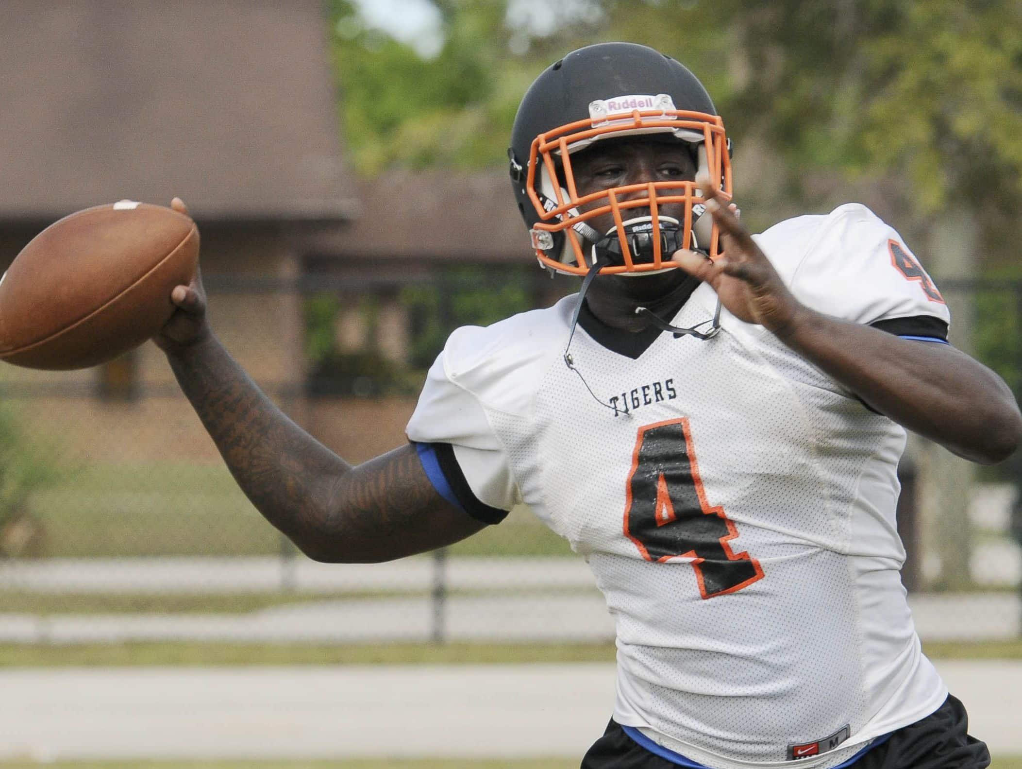 Cocoa High School QB Bruce Judson throws to an open receiver during a preseason practice.