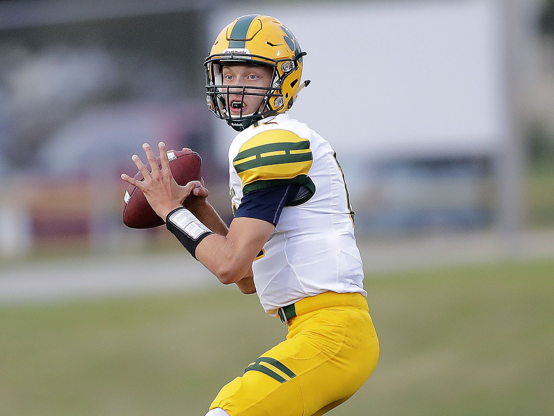 Ashwaubenon senior Ryan Johnson signed a national letter of intent with Northern Michigan University, becoming the third quarterback in as many years from the high school to sign a letter of intent with an NCAA Division I or II program.
