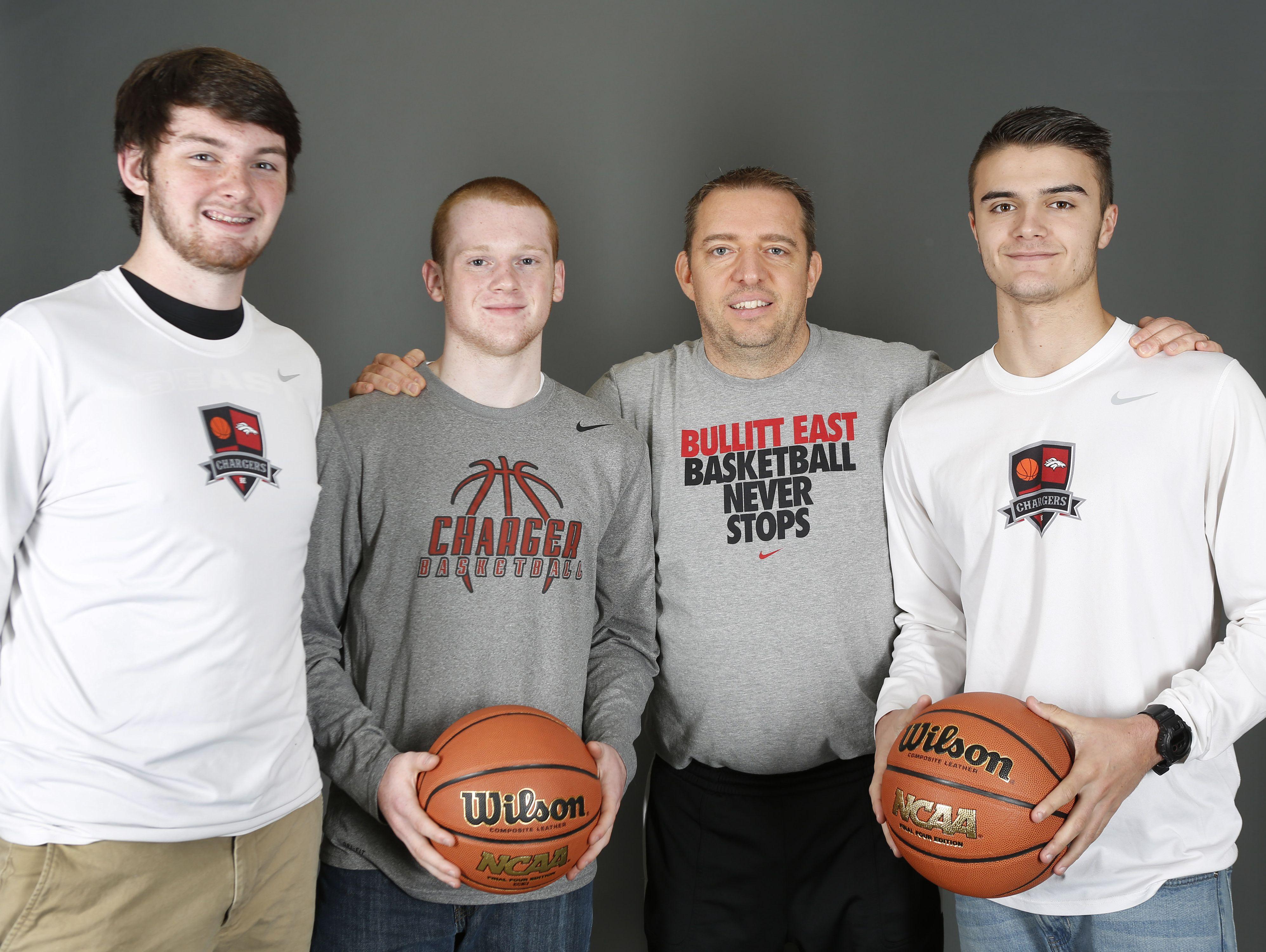 Bullitt East High School basketball players, Grant Skaggs, left, Jared Osborne, coach Jason Couch and Conner Green, right. Nov. 7, 2016