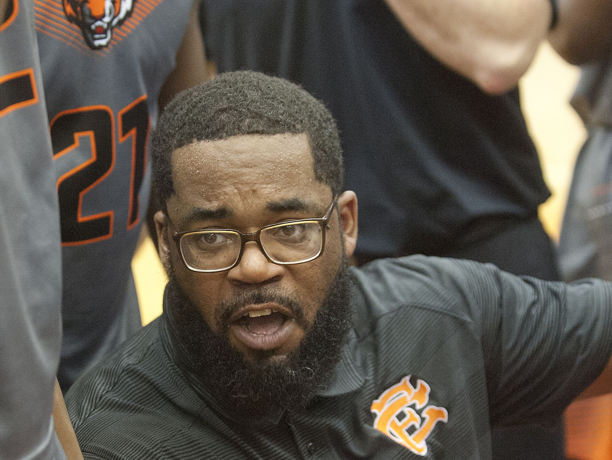 Fern Creek head basketball coach James Schooler, III talks to his players during a time-out. 16 December 2016