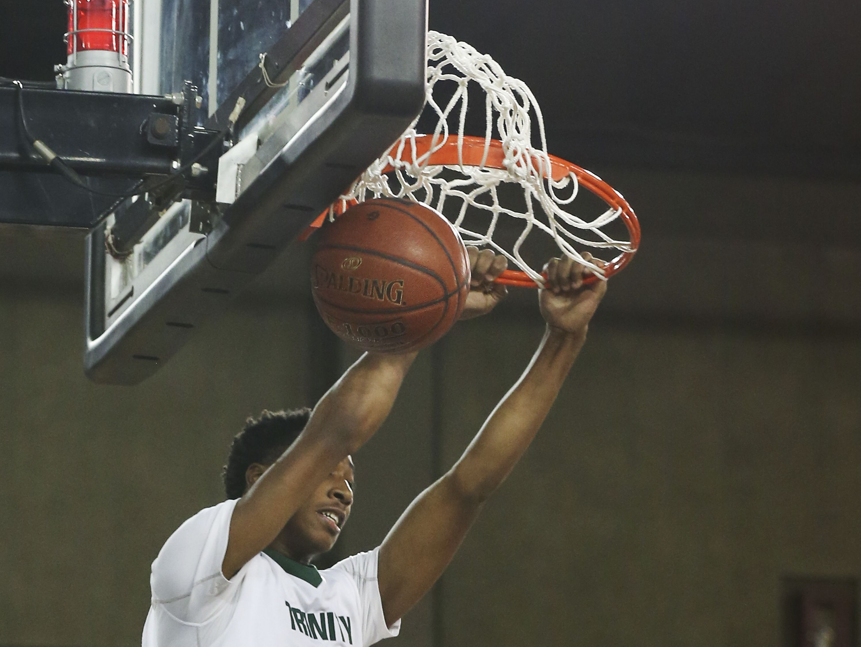 Trinity's Jay Scrubb (31) dunks on a fast break against St. X during their game at Broadbent Arena. Jan. 6, 2017