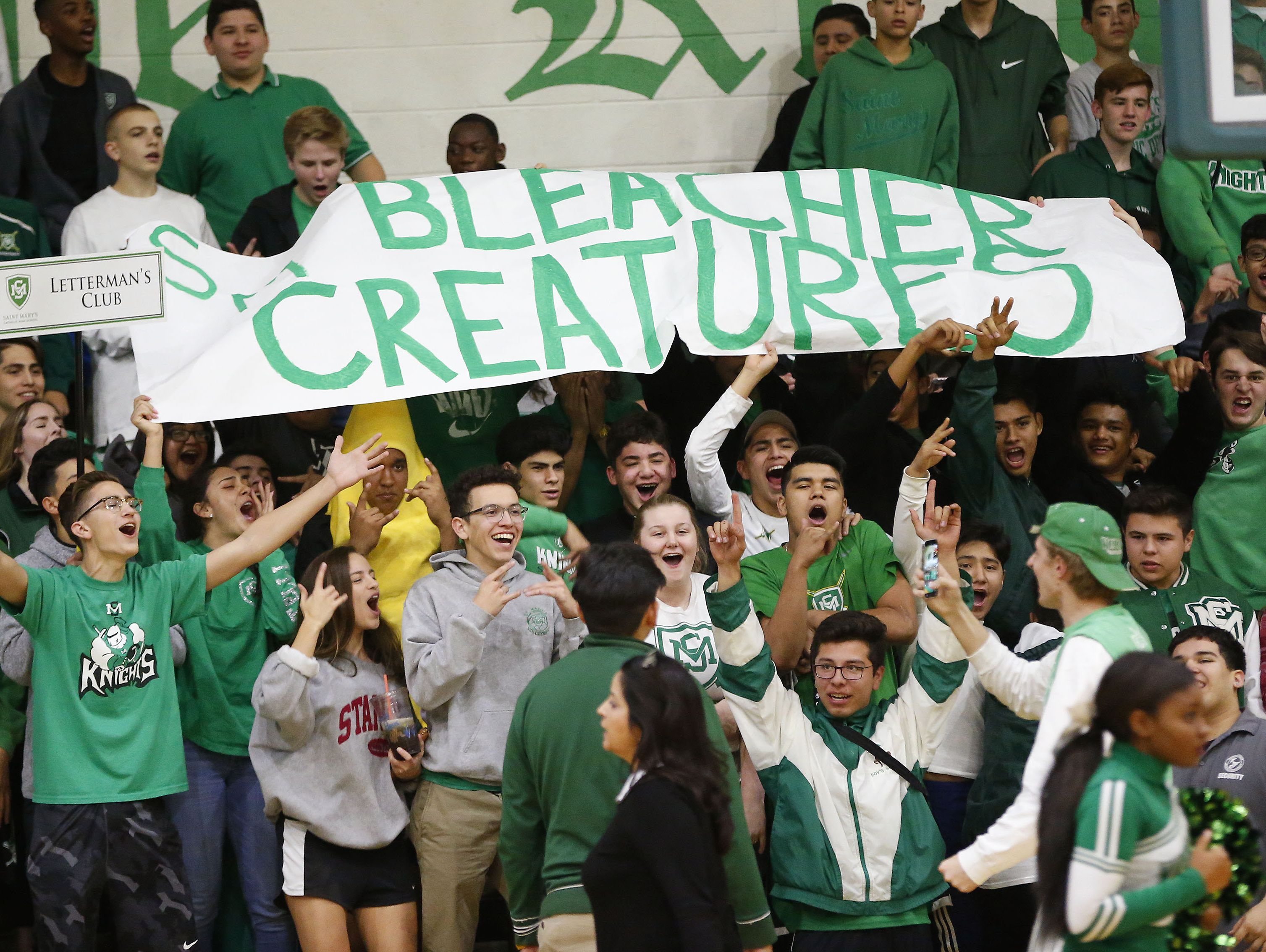 """St. Mary's """"Bleacher Creatures"""" cheer during a game against Shadow Muntain at the St. Mary's High School gym in Phoenix, Ariz, Jan. 24, 2017."""