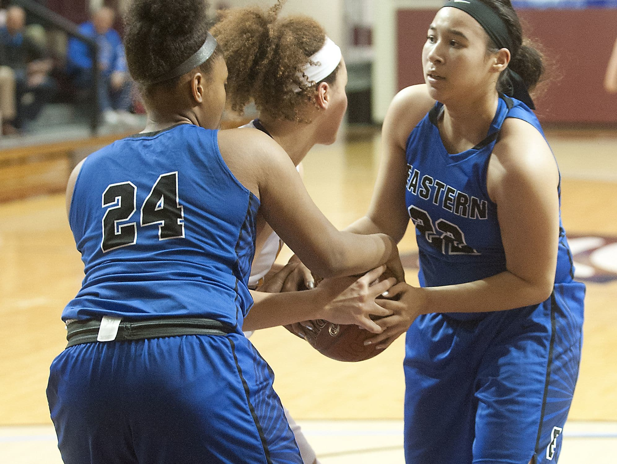 Eastern center Destiny Houseal, left, and Eastern guard-forward Natalie Collins tie up Male center Cameron Browning in the second round of the Girls LIT. 25 January 2017