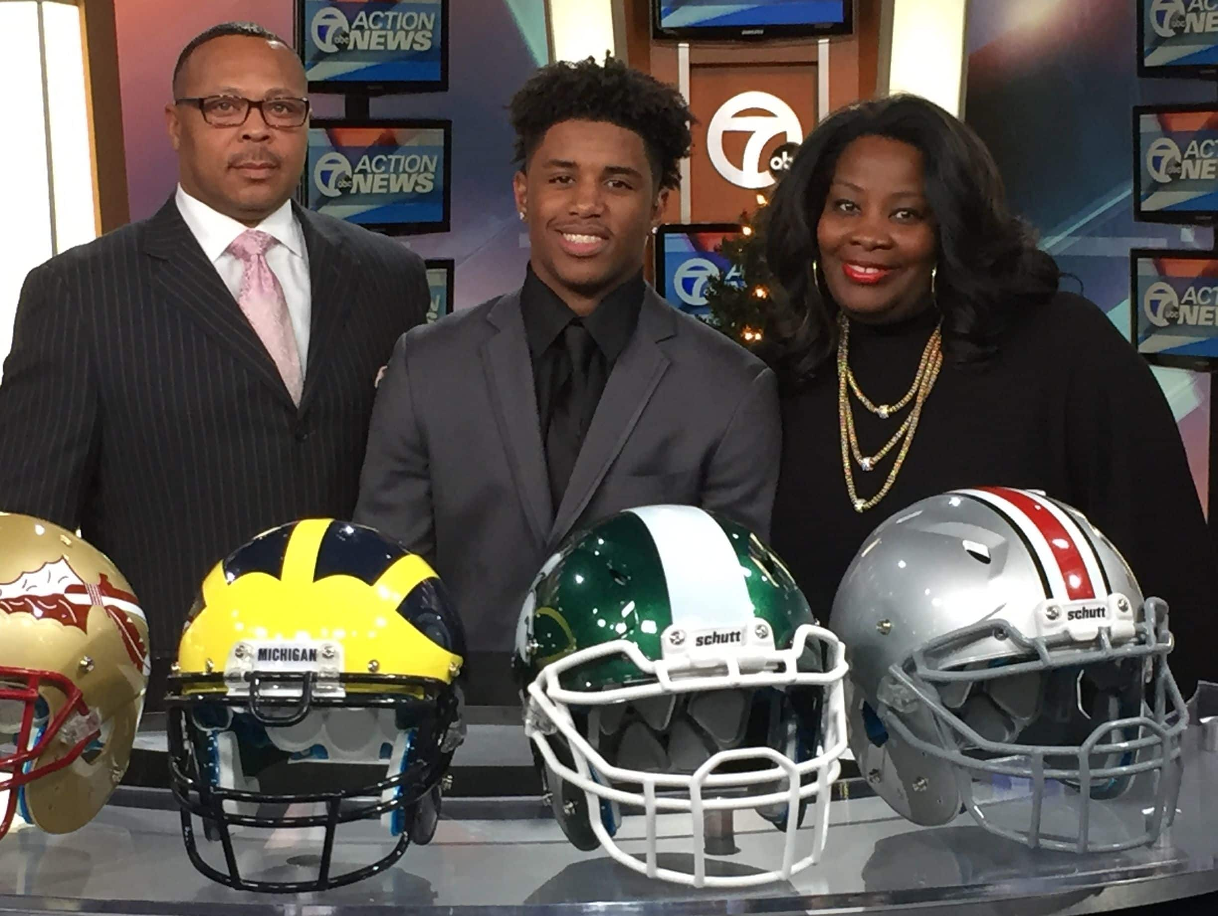 Detroit Cass Tech senior Donovan Peoples-Jones was joined by coach Thomas Wilcher and principal Lisa Phillips for the announcement.