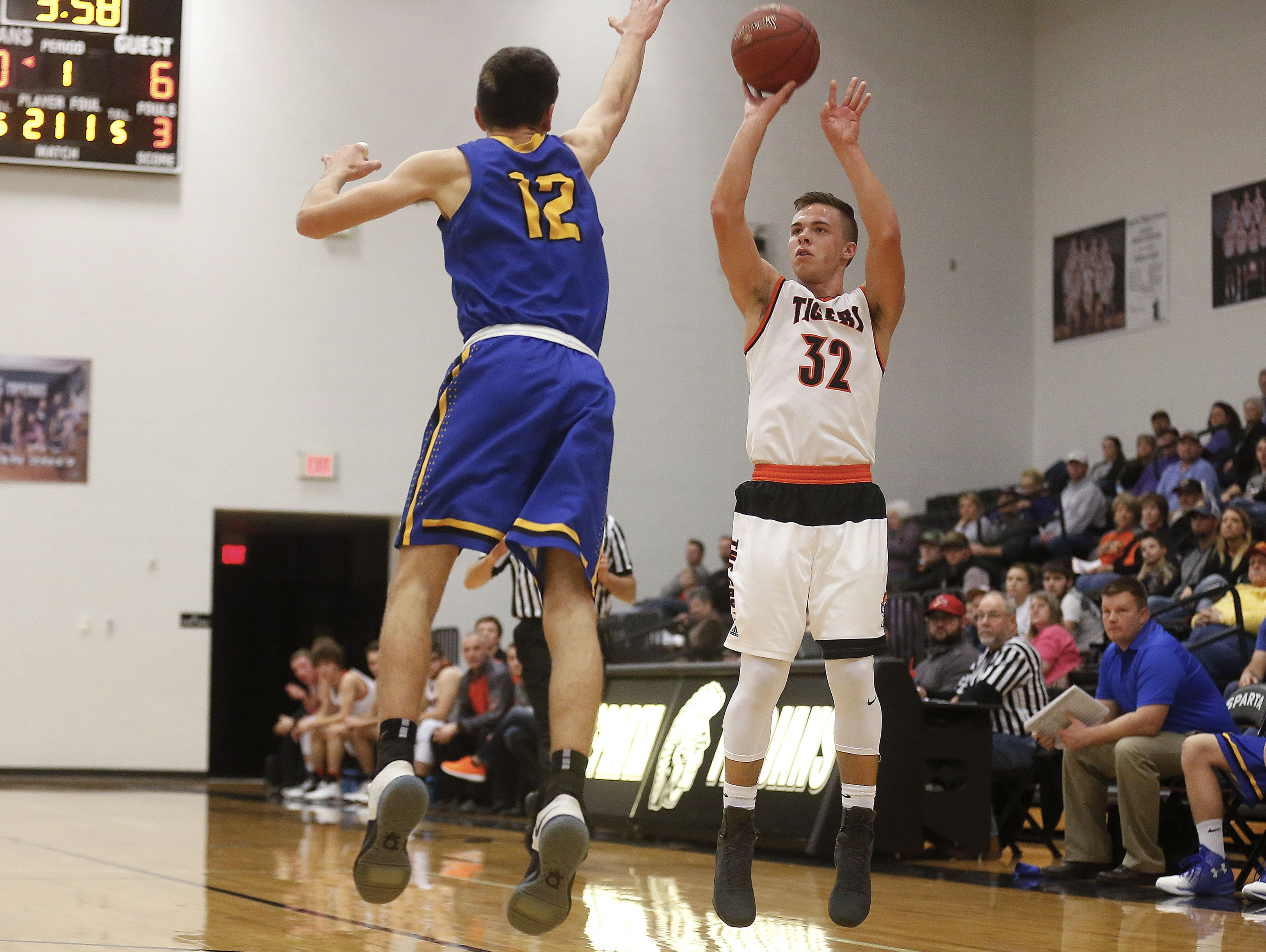 Walnut Grove High School guard Logan Thomazin (32) shoots from three-point range during first quarter action of the high school basketball game between the Walnut Grove Tigers and the Fordland Eagles at Sparta High School in Sparta, Mo. on Jan. 26, 2017. Logan Thomazin broke the Walnut Grove career scoring record with a free throw in the second quarter of the game.