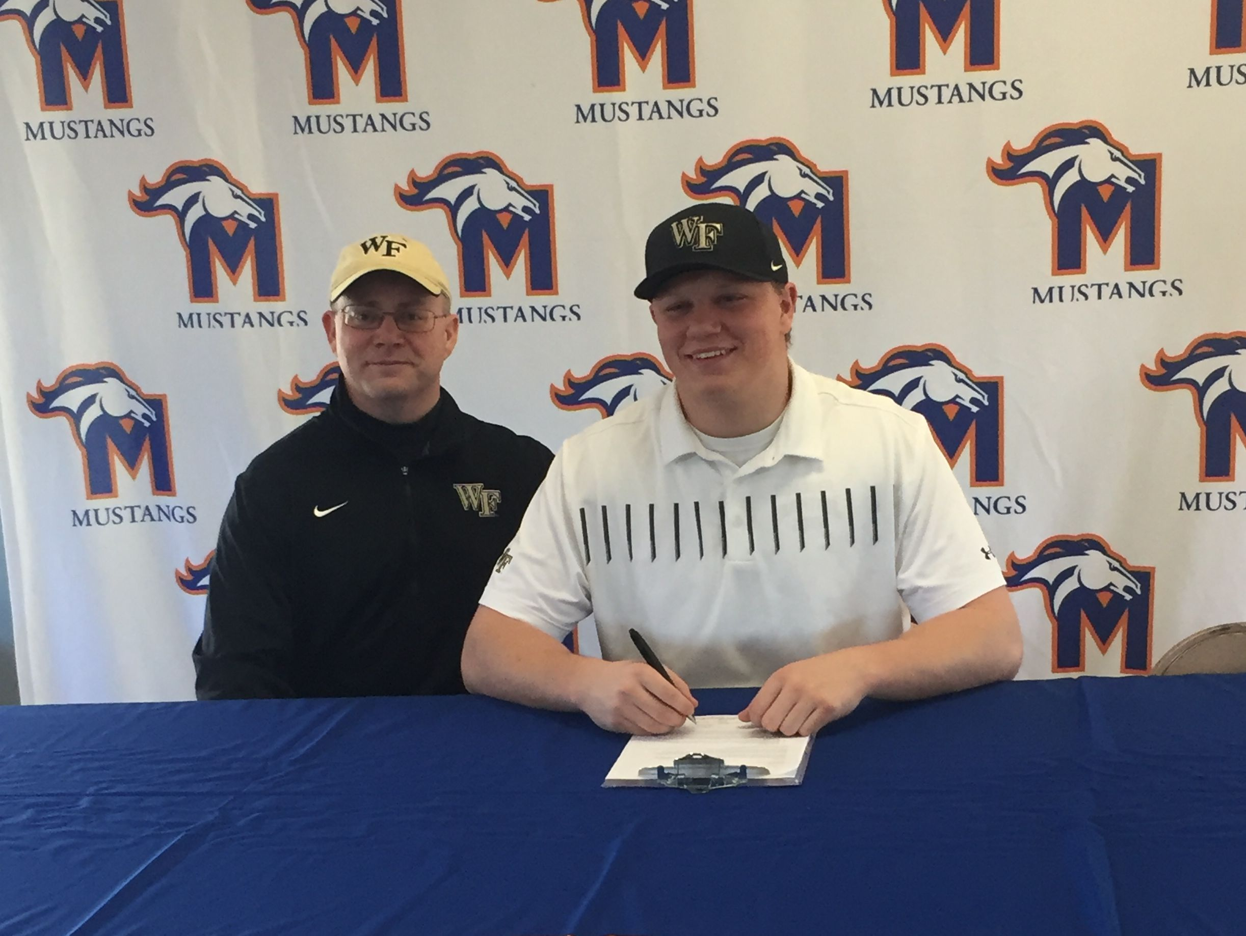 Millbrook native Allan Rappleyea, a Milton Academy senior, signs his national letter of intent to play football at Wake Forest University.