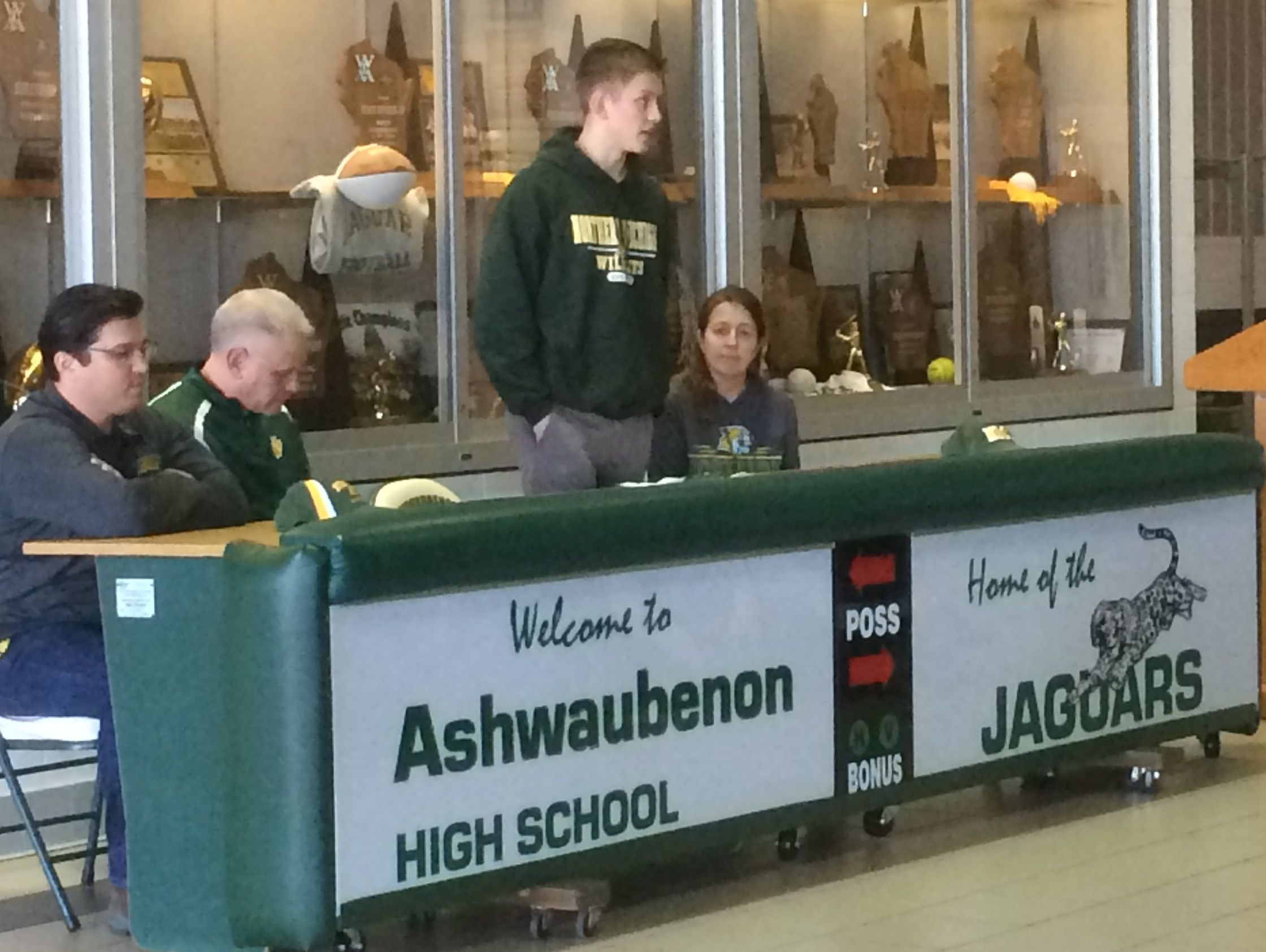 Ashwaubenon senior Ryan Johnson speaks to a gathering of teammates, coaches, friends and family at the school's fieldhouse about what it means to him to sign a national letter of intent with Northern Michigan University.