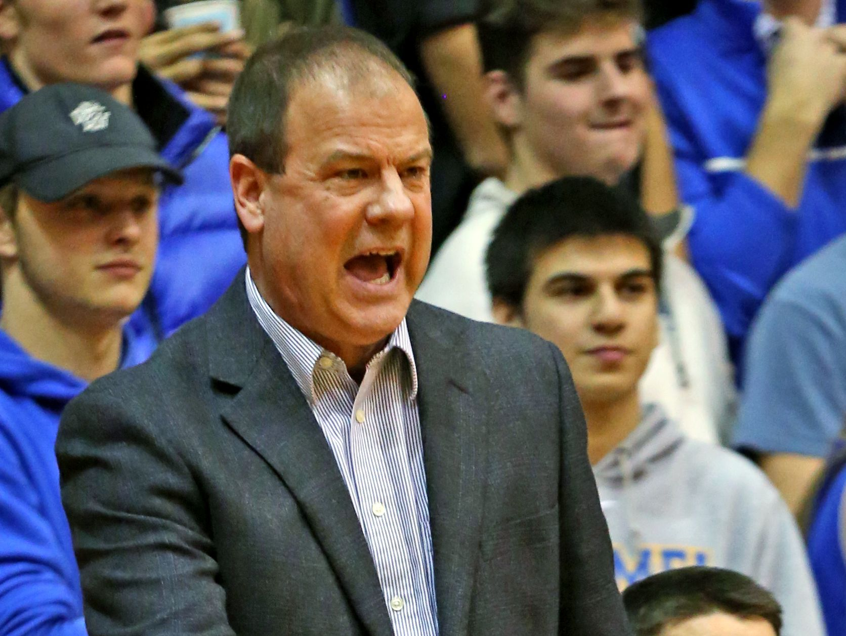 Carmel Coach Scott Heady yells to his team during first half action of the Carmel at North Central High School boys basketball game, Friday, December 16, 2016.