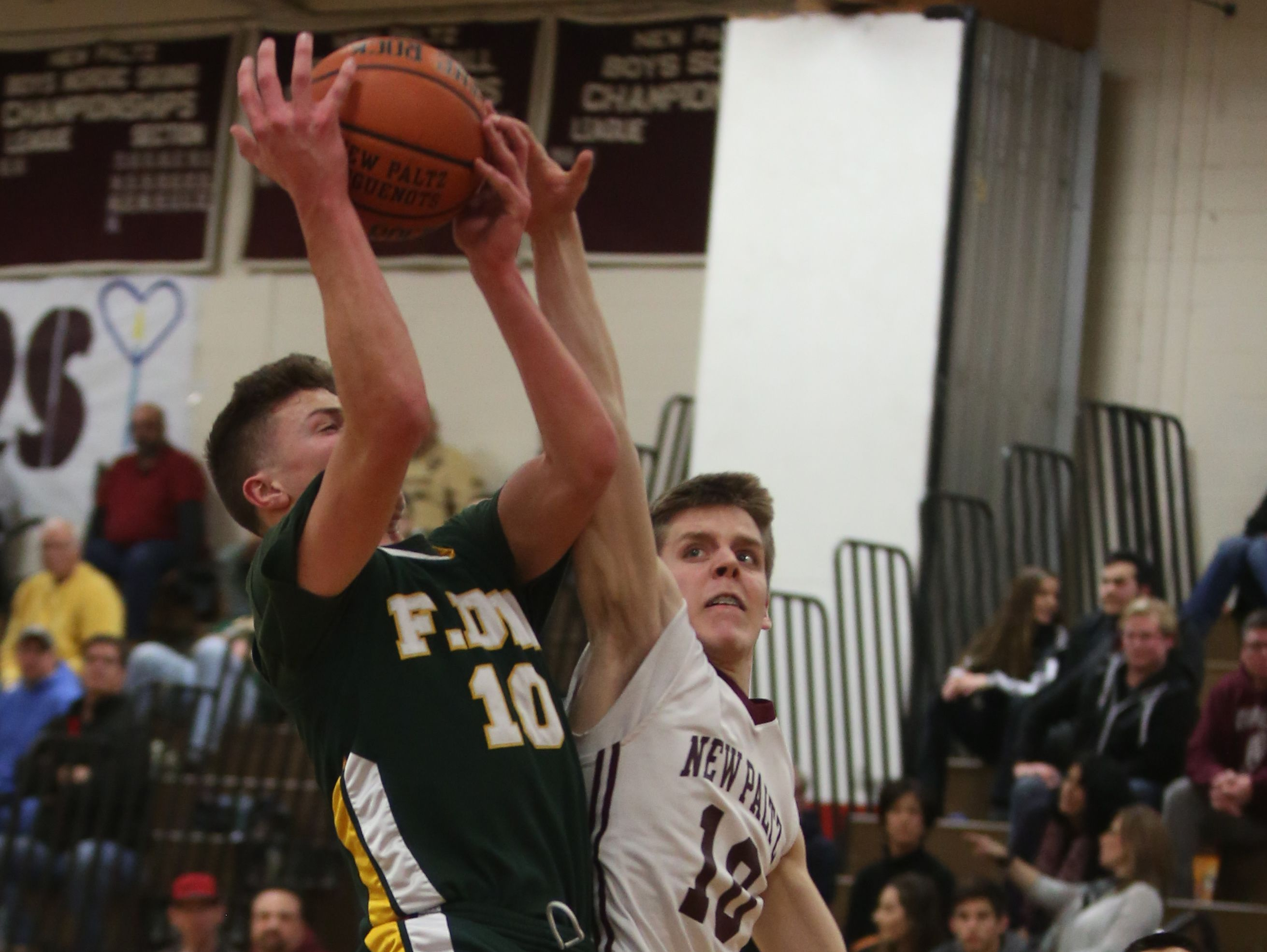 New Paltz's Charlie Perez (10) tries to block Franklin D. Roosevelt's Ethan Hart (10) layup during basketball game at New Paltz High School on Feb. 3, 2017.
