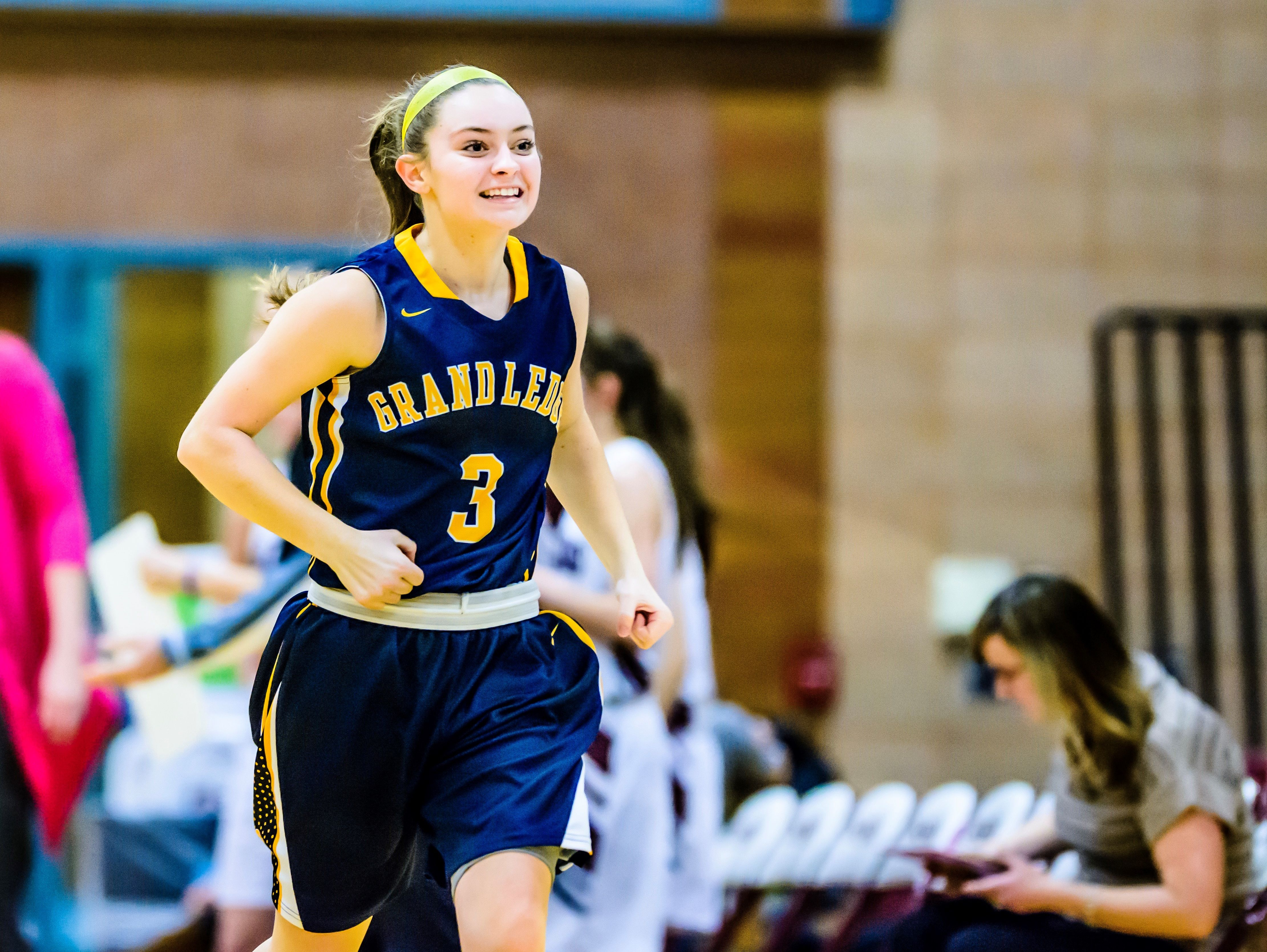 Mackenzie Todd of Grand Ledge celebrates as she runs back to the bench in a timeout after Grand Ledge took a 27-15 lead over Okemos in the 3rd quarter of their game Friday February 3, 2017 in Okemos.