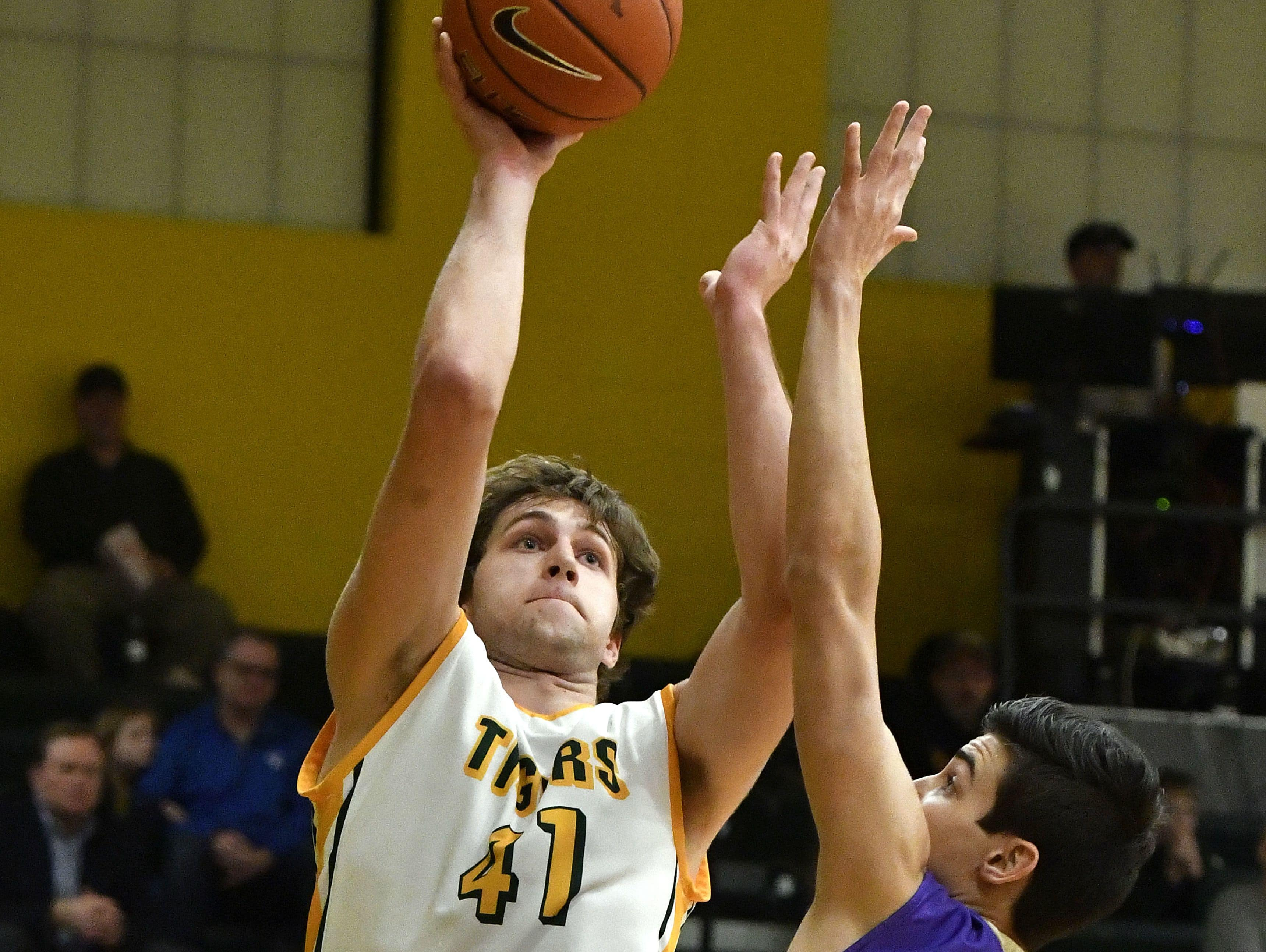 St. Xavier's Pierce Kiesler (41) puts up a shot up over the defense of Male's Shane Doughty (25) during action of their game, Friday, Feb. 03, 2017 in Louisville Ky.