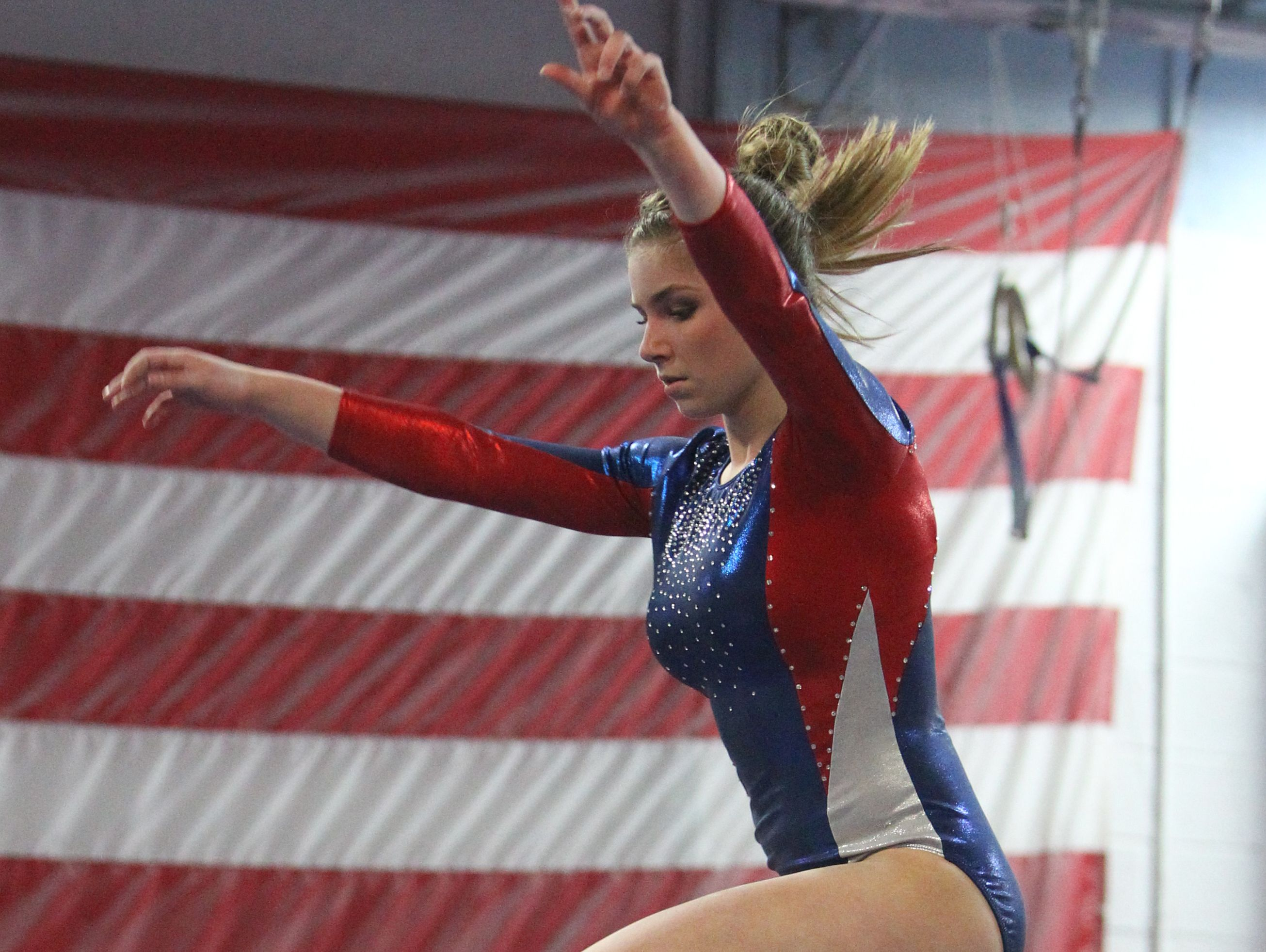 Wappingers' Olivia Frederick performs on the balance beam at the Section 1 Division I and II gymnastics championships at Odyssey Gymnastics Center in Mahopac on Tuesday.