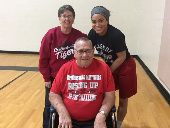 Linda Luedeman (back left) and granddaughter Katrina Christian (back right) with Christian's great grandfather Fran Schill, a 1956 Crothersville graduate and former coach and administrator at the school.